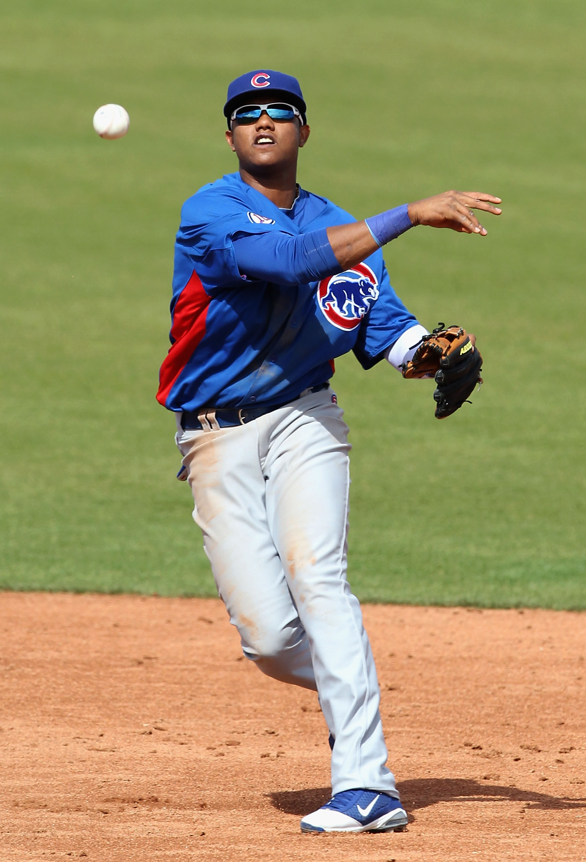 SCOTTSDALE, AZ - MARCH 01:  Infielder Starlin Castro #13 of the Chicago Cubs throws to first base attempting to turn a double play during the spring training game against the San Francisco Giants at Scottsdale Stadium on March 1, 2011 in Scottsdale, Arizo