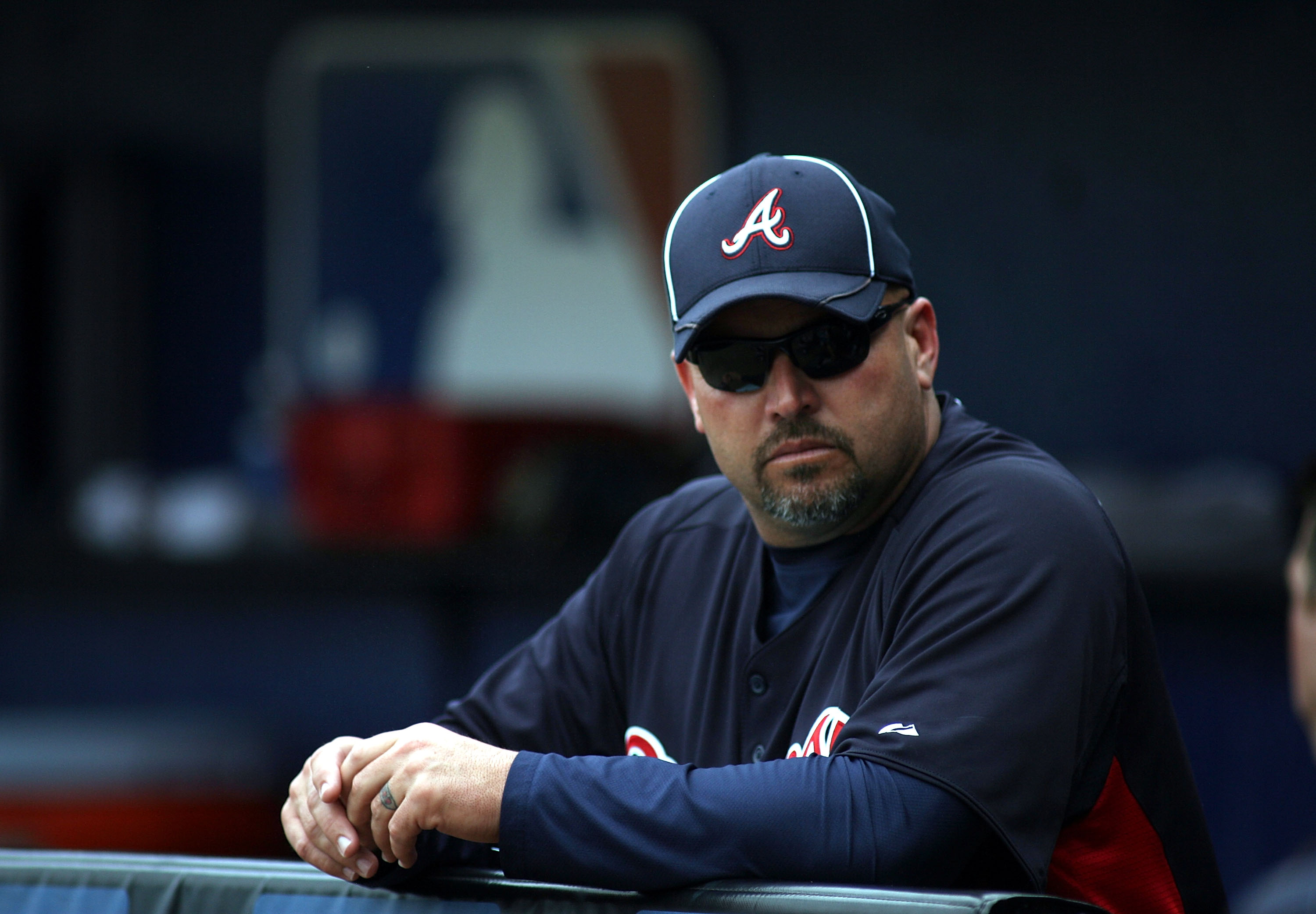 PORT ST. LUCIE, FL - FEBRUARY 26:  Manager Freddie Gonzalez of the Atlanta Braves watches  prior to playing against the New York Mets at Digital Domain Park on February 26, 2011 in Port St. Lucie, Florida.  (Photo by Marc Serota/Getty Images)