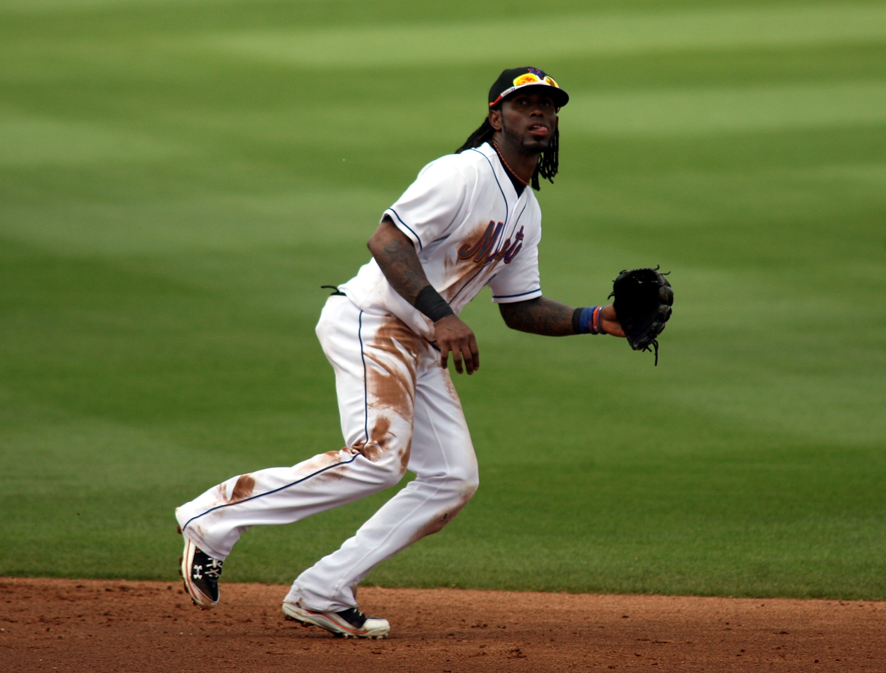 PORT ST. LUCIE, FL - MARCH 03: Shortstop Jose Reyes #7 of the New York Mets plays the field against the St. Louis Cardinals stealing second base at Digital Domain Park on March 3, 2011 in Port St. Lucie, Florida.  (Photo by Marc Serota/Getty Images)