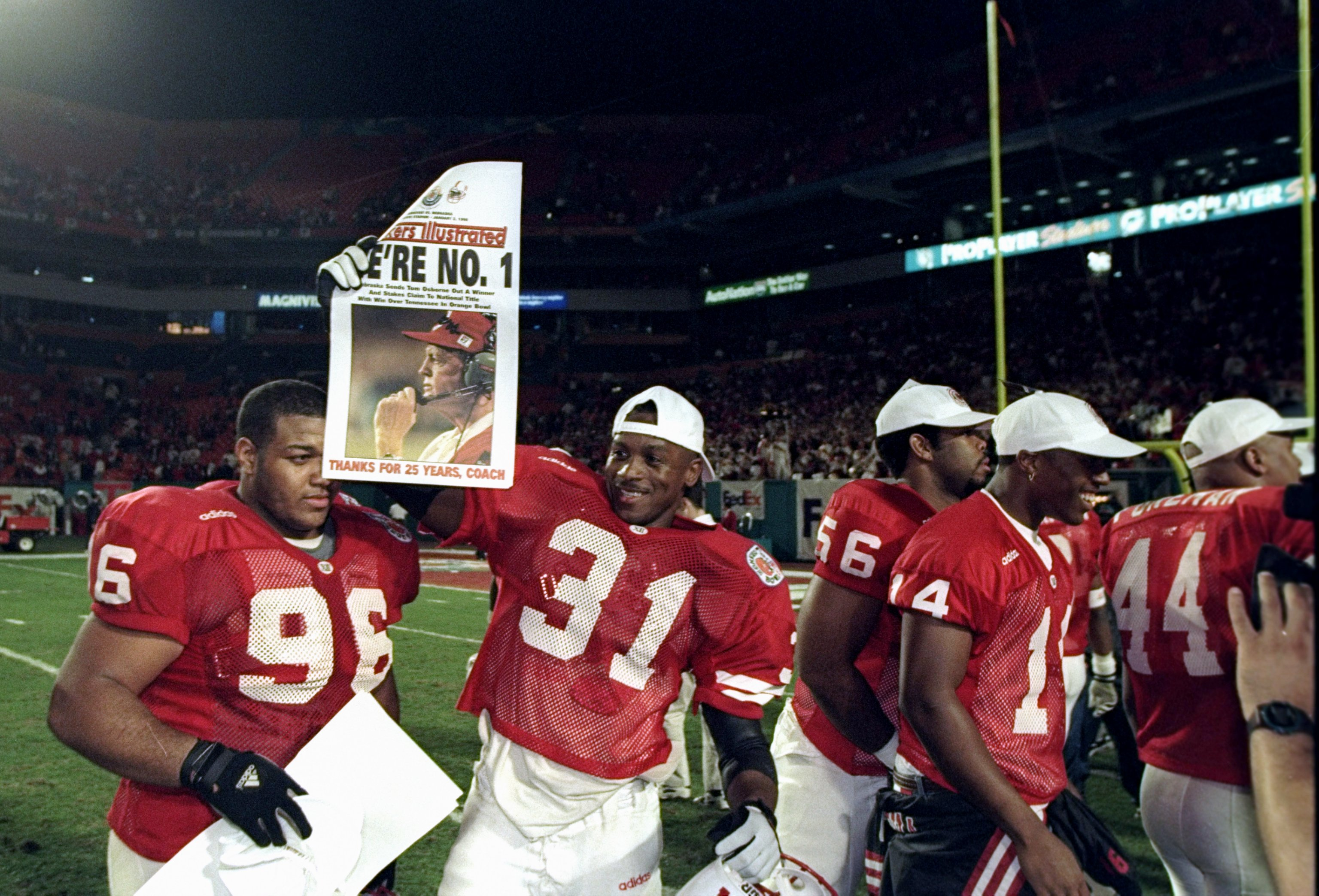 2 Jan 1998: Several Nebraska Cornhuskers players celebrate after the Orange Bowl against the Tennessee Volunteers at Pro Player Stadium in Miami, Florida. Nebraska won the game, 42-17.