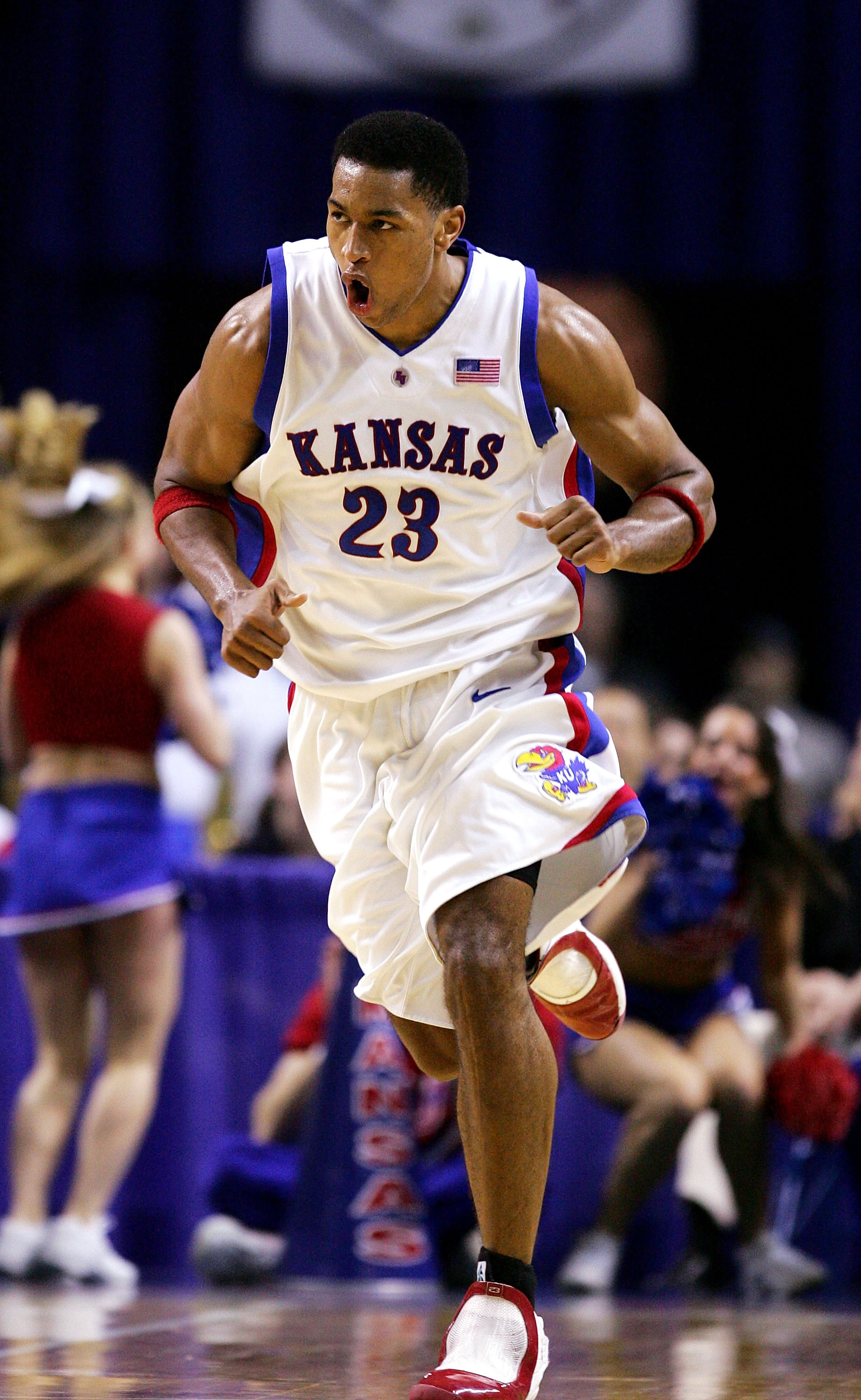 KANSAS CITY, MO - MARCH 11:  Wayne Simien #23 of the Kansas Jayhawks is excited as he runs back on defense in the second half against the Kansas State Wildcats in Day 2 of the Phillips 66 Big 12 Men's Basketball Tournament at Kemper Arena on March 11, 200