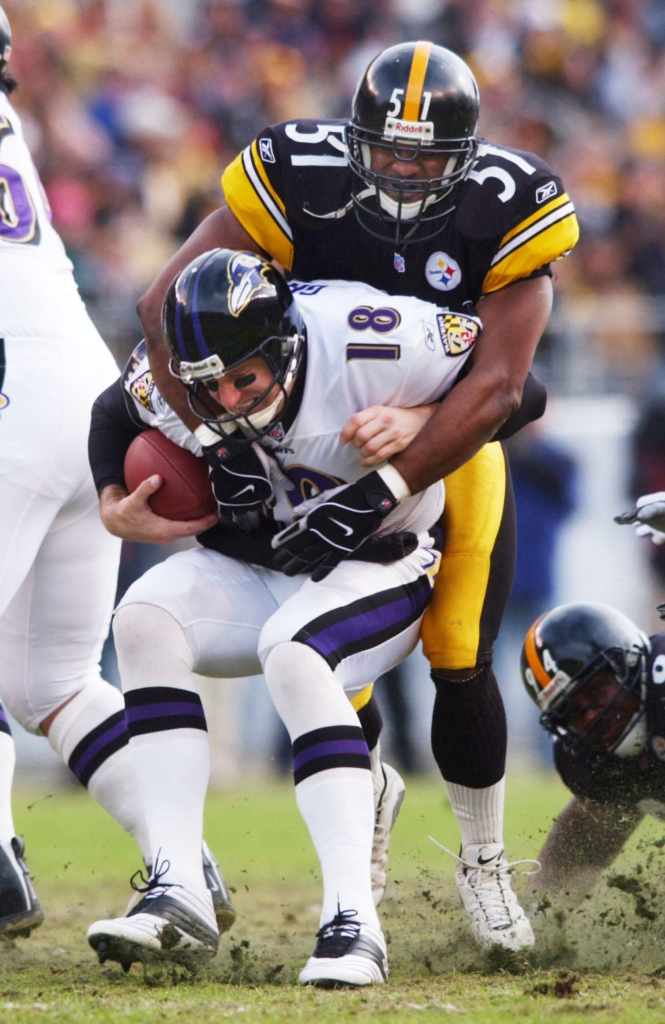 20 Jan 2002:  Mike Jones #51 of the Pittsburgh Steelers collects a sack on Elvis Grbac #18 of the Baltimore Ravens in AFC Playoff action at Heinz Field in Pittsburgh, Pennsylvania. DIGITAL IMAGE. Mandatory Credit: Doug Pensinger/Getty Images