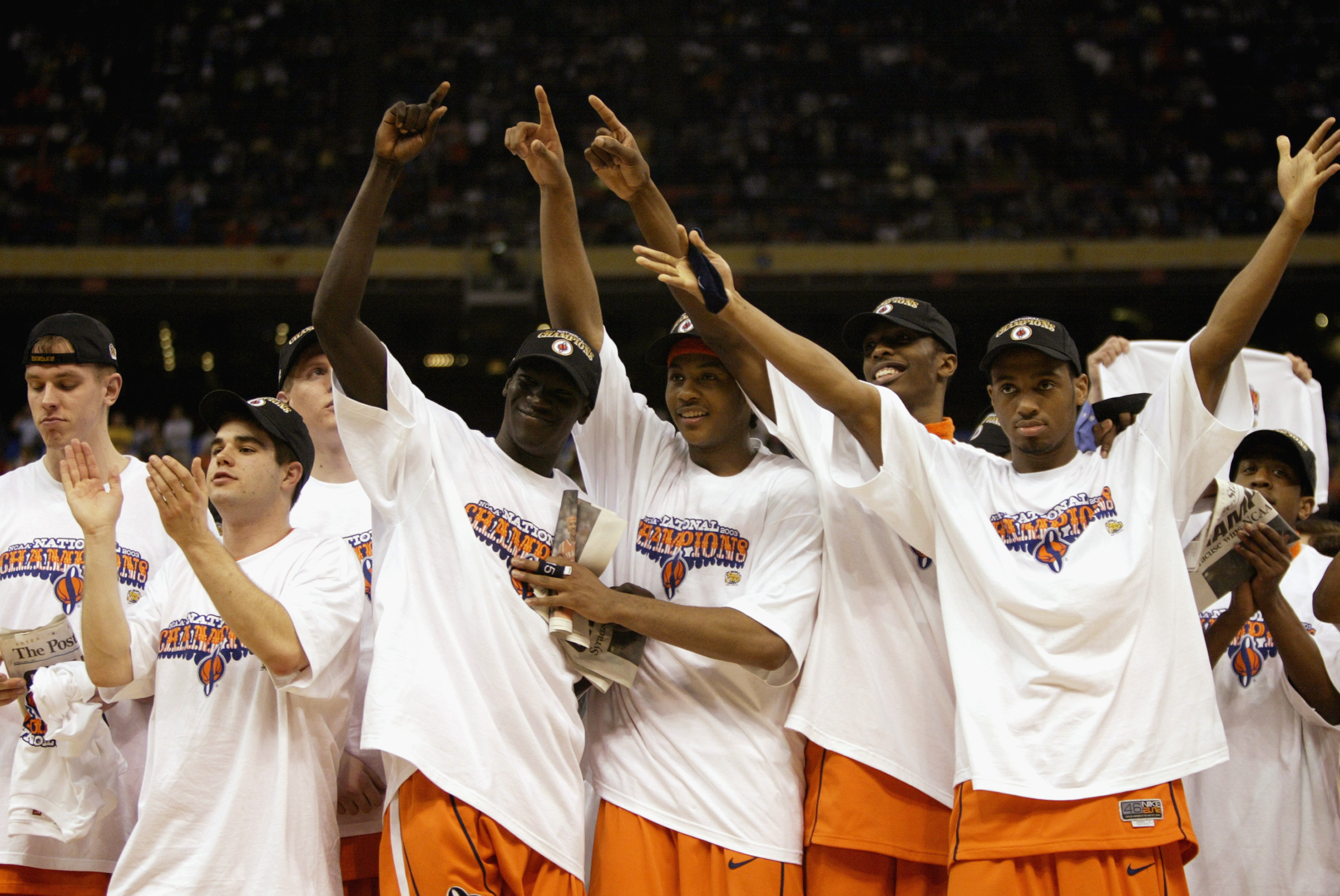 NEW ORLEANS - APRIL 7:  The Syracuse team (including Most Outstanding Player Carmelo Anthony #15, center) celebrates while wearing their championship tee shirts and caps after the victory against Kansas in the championship game of the NCAA Men's Final Fou