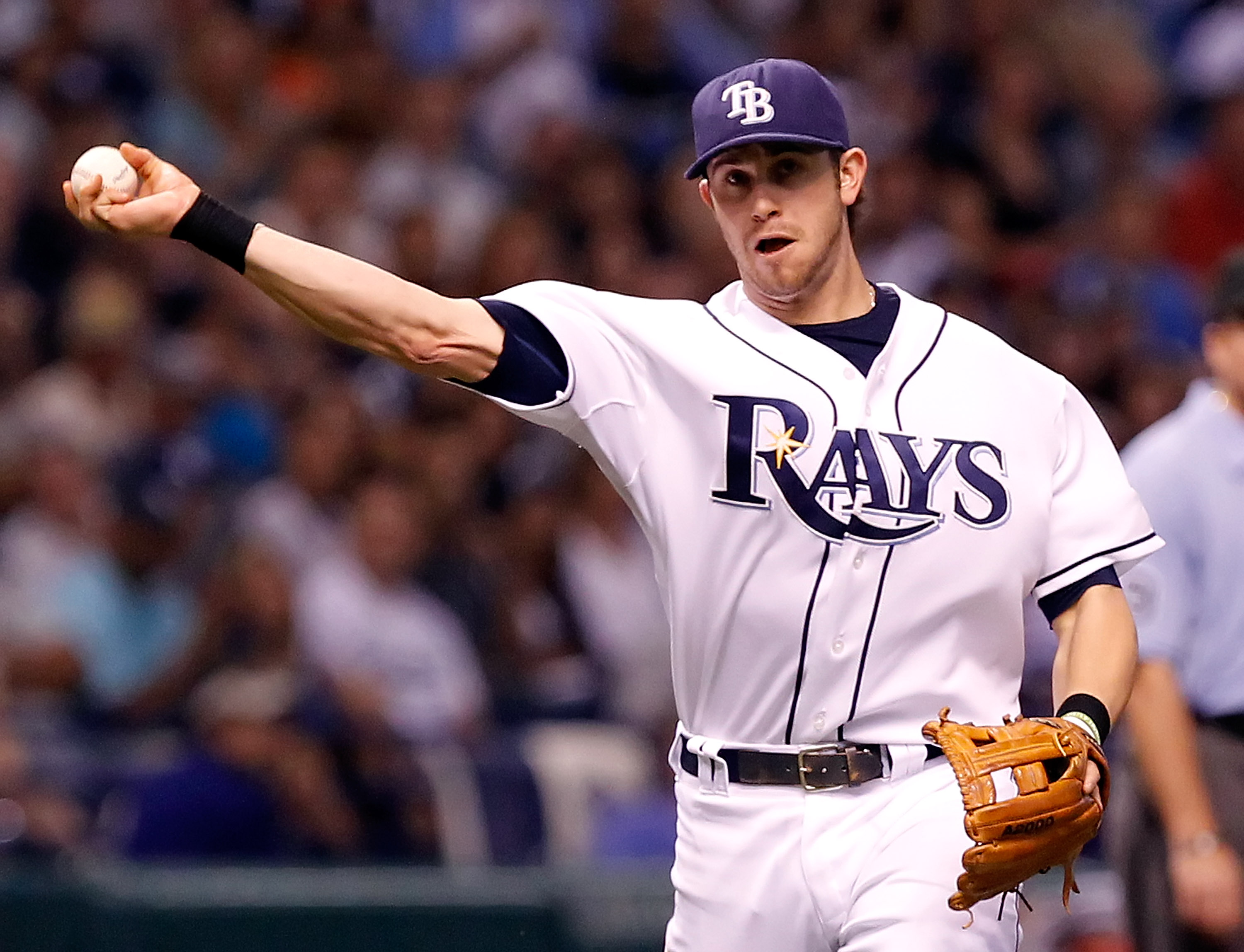 ST. PETERSBURG - SEPTEMBER 13:  Infielder Evan Longoria #3 of the Tampa Bay Rays throws over to first for an out against the New York Yankees during the game at Tropicana Field on September 13, 2010 in St. Petersburg, Florida.  (Photo by J. Meric/Getty Im