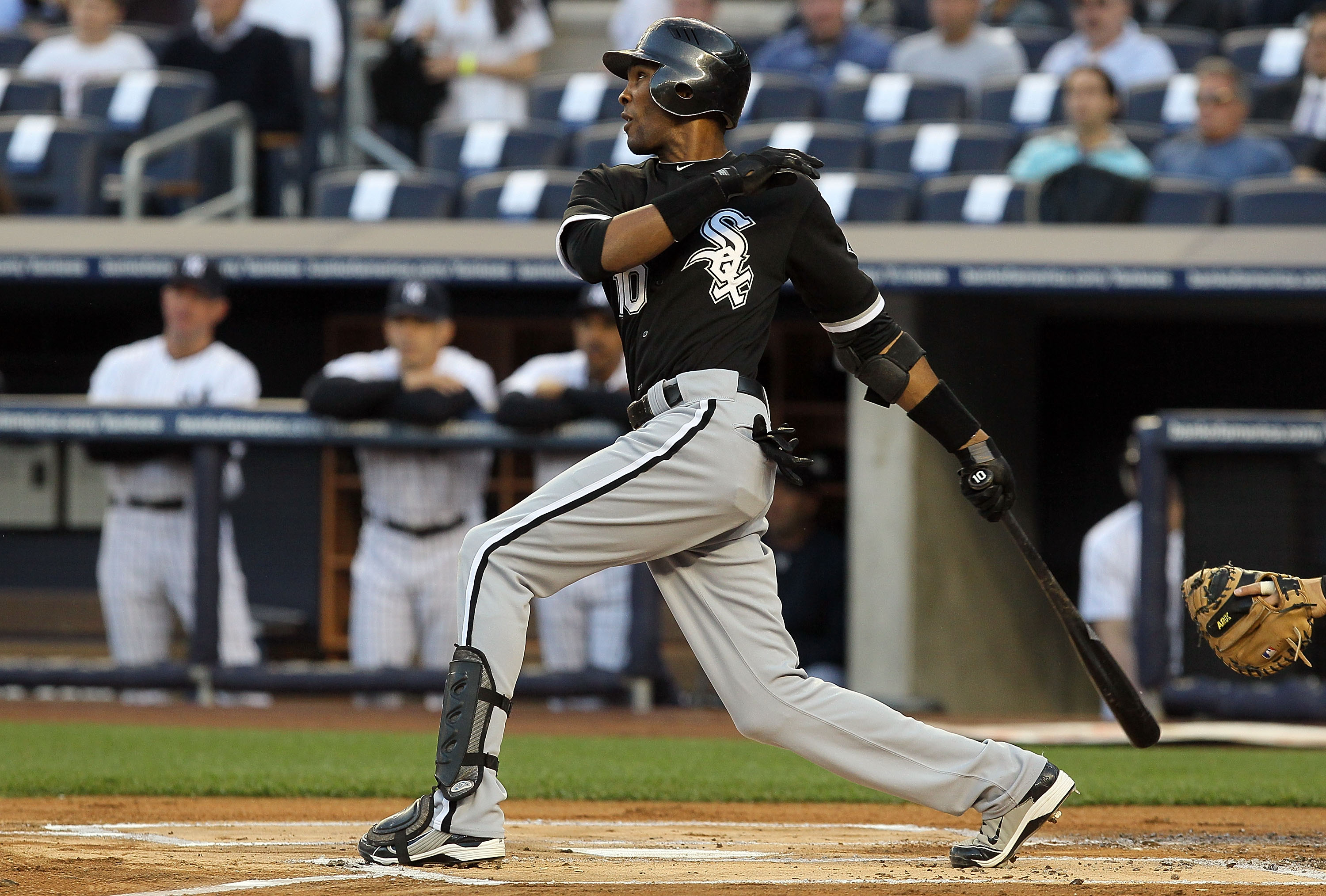 NEW YORK - APRIL 30:  Alexei Ramirez #10 of the Chicago White Sox follows through on a lead off base hit against the New York Yankees on April 30, 2010 at Yankee Stadium in the Bronx borough of New York City.  (Photo by Jim McIsaac/Getty Images)