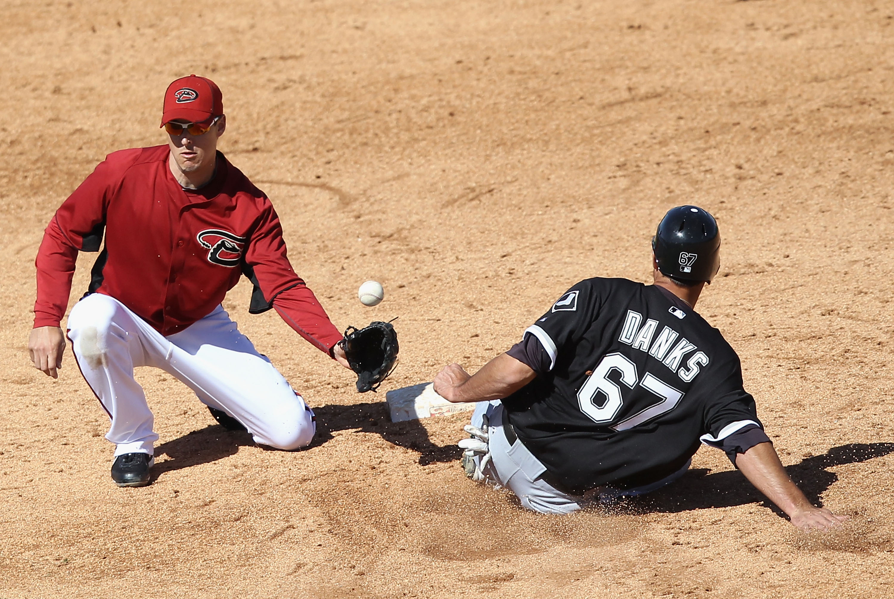 TUCSON, AZ - MARCH 07:  Jordan Danks #67 of the Chicago White Sox safely steals second base past infielder Kelly Johnson #2 of the Arizona Diamondbacks during the fifth inning of the spring training game at Kino Veterans Memorial Stadium on March 7, 2011