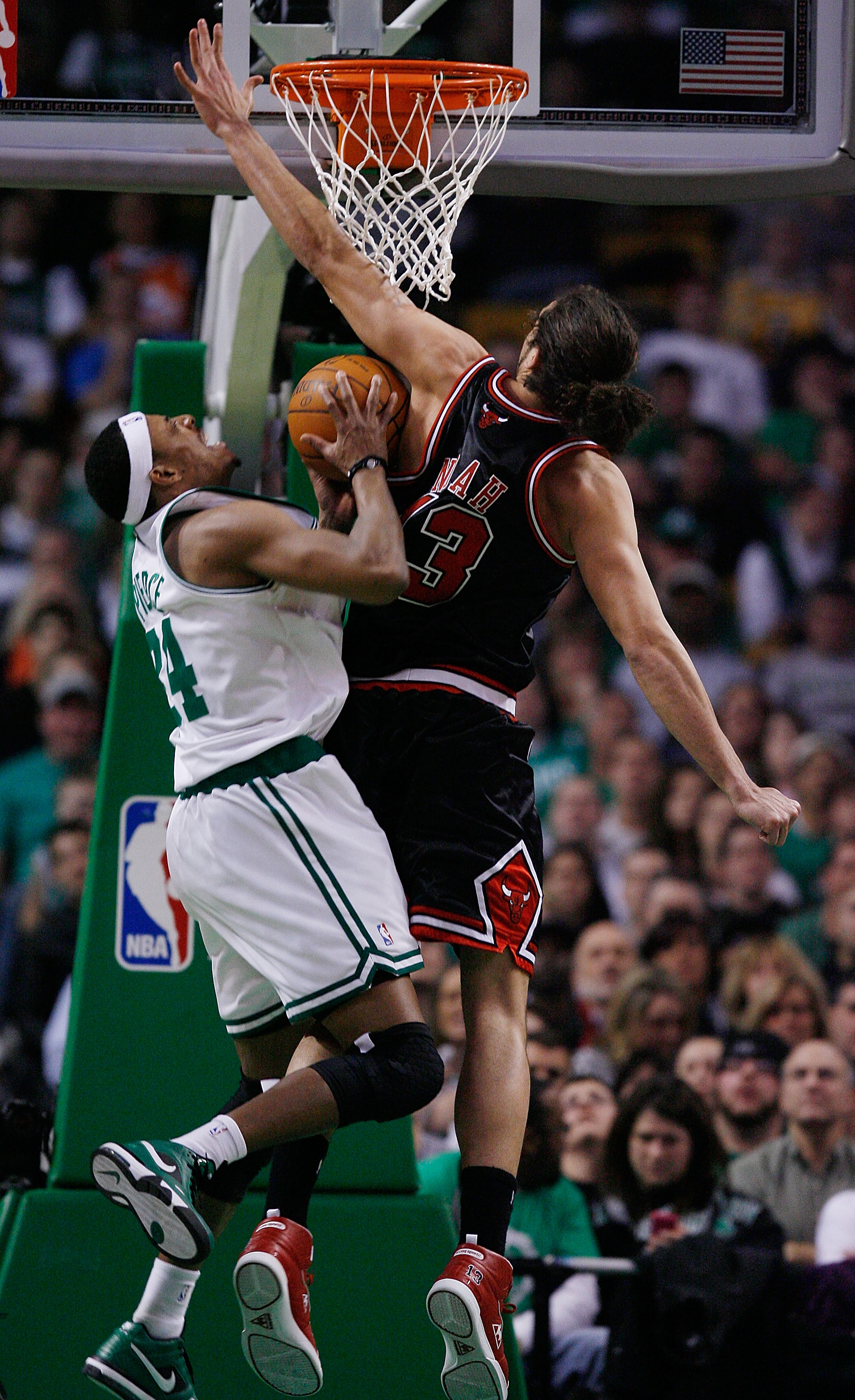 BOSTON - JANUARY 14:  Paul Pierce #34 of the Boston Celtics is blocked by Joakim Noah #13 of the Chicago Bulls at the TD Garden on January 14, 2010 in Boston, Massachusetts. The Bulls defeated the Celtics 96-83. NOTE TO USER: User expressly acknowledges a