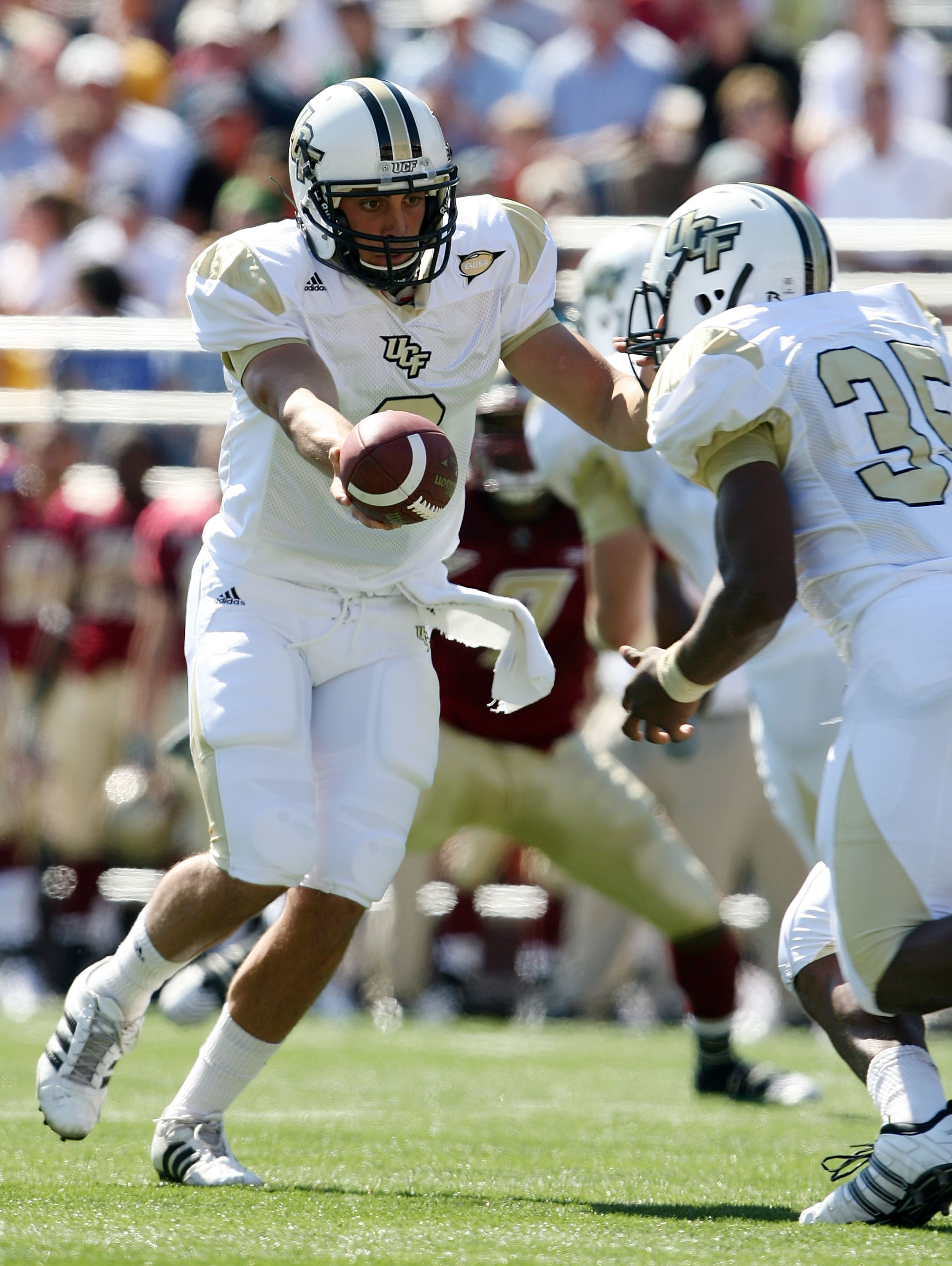 CHESTNUT HILL, MA - SEPTEMBER 20:  Michael Greco #2 of the Central Florida Knights hands the ball off to Ronnie Weaver #35 in the first half against the Boston College Eagles on September 20, 2008 at Alumni Stadium in Chestnut Hill, Massachusetts.  (Photo