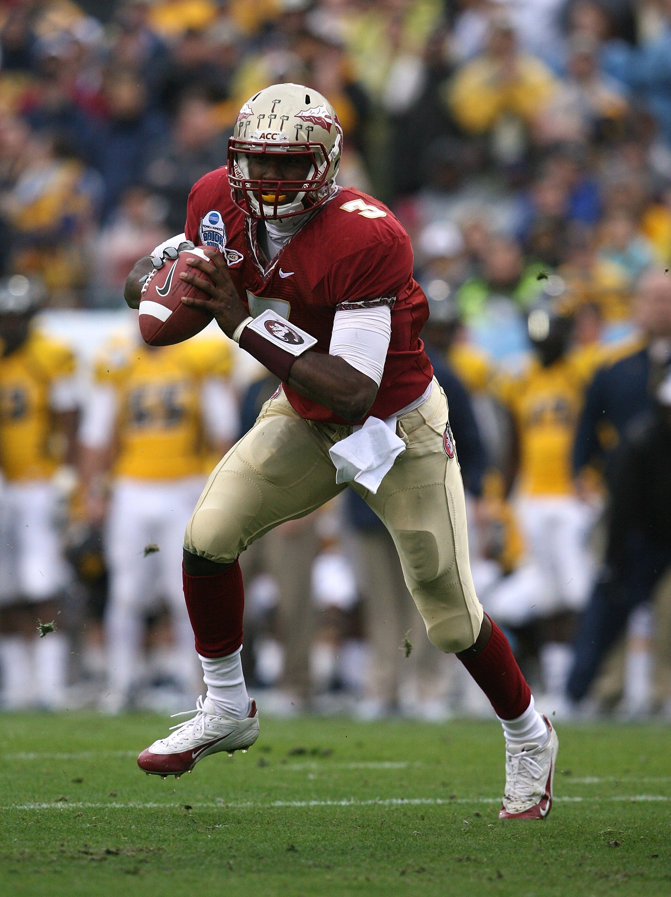 JACKSONVILLE, FL - JANUARY 01:  Quarterback E.J. Manuel #3 of the Florida State Seminoles scrambles against the West Virginia Mountaineers during the Konica Minolta Gator Bowl on January 1, 2010 at Jacksonville Municipal Stadium in Jacksonville, Florida.