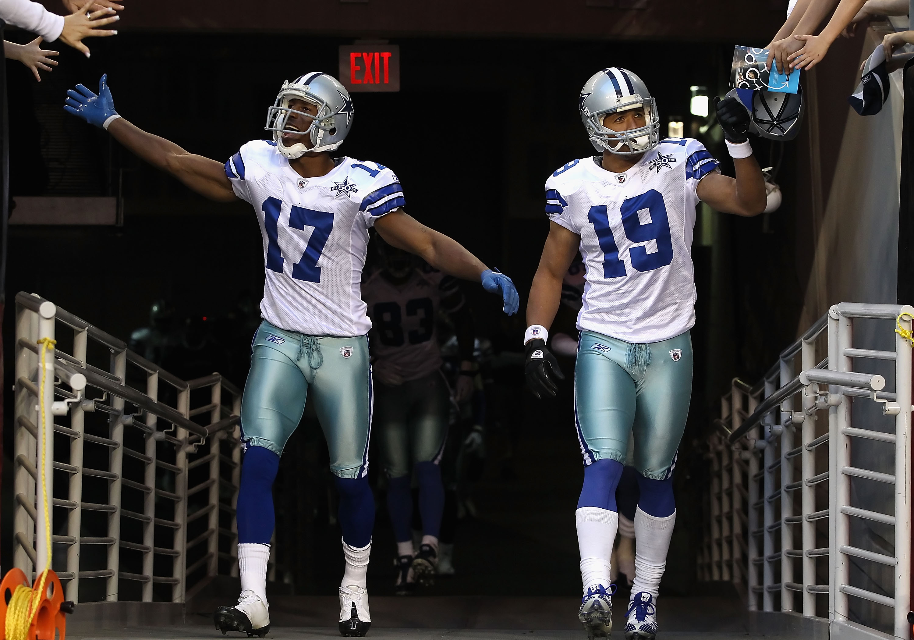 GLENDALE, AZ - DECEMBER 25:  Sam Hurd #17 and Miles Austin #19 of the Dallas Cowboys walk out onto the field before the NFL game against the Arizona Cardinals at the University of Phoenix Stadium on December 25, 2010 in Glendale, Arizona.  The Cardinals d
