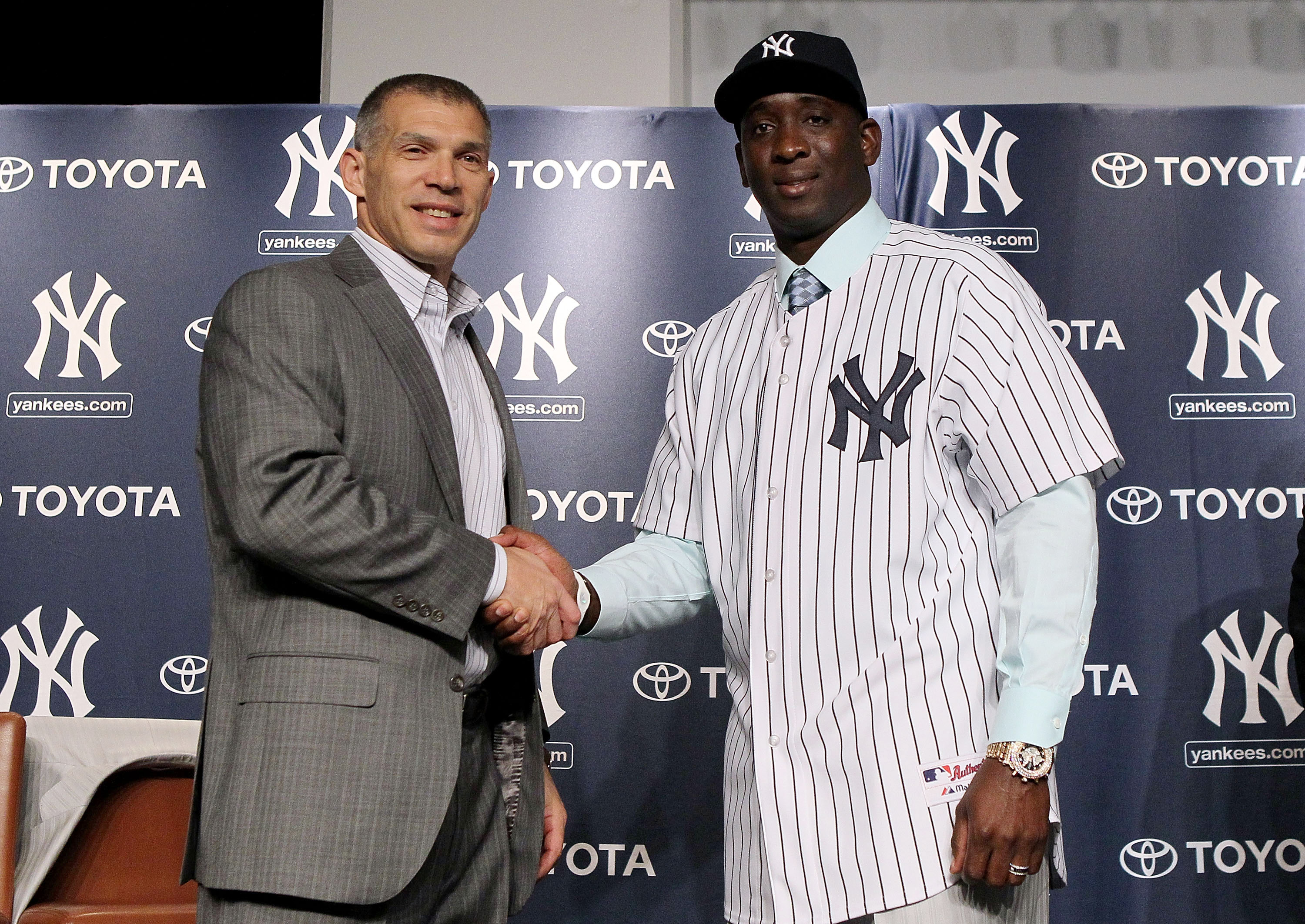 NEW YORK, NY - JANUARY 19:  Rafael Sorianoof the New York Yankees shakes hands with manager Joe Girardi during his introduction press conference on January 19, 2011 at Yankee Stadium in the Bronx borough of New York City. The Yankees signed Soriano to a t