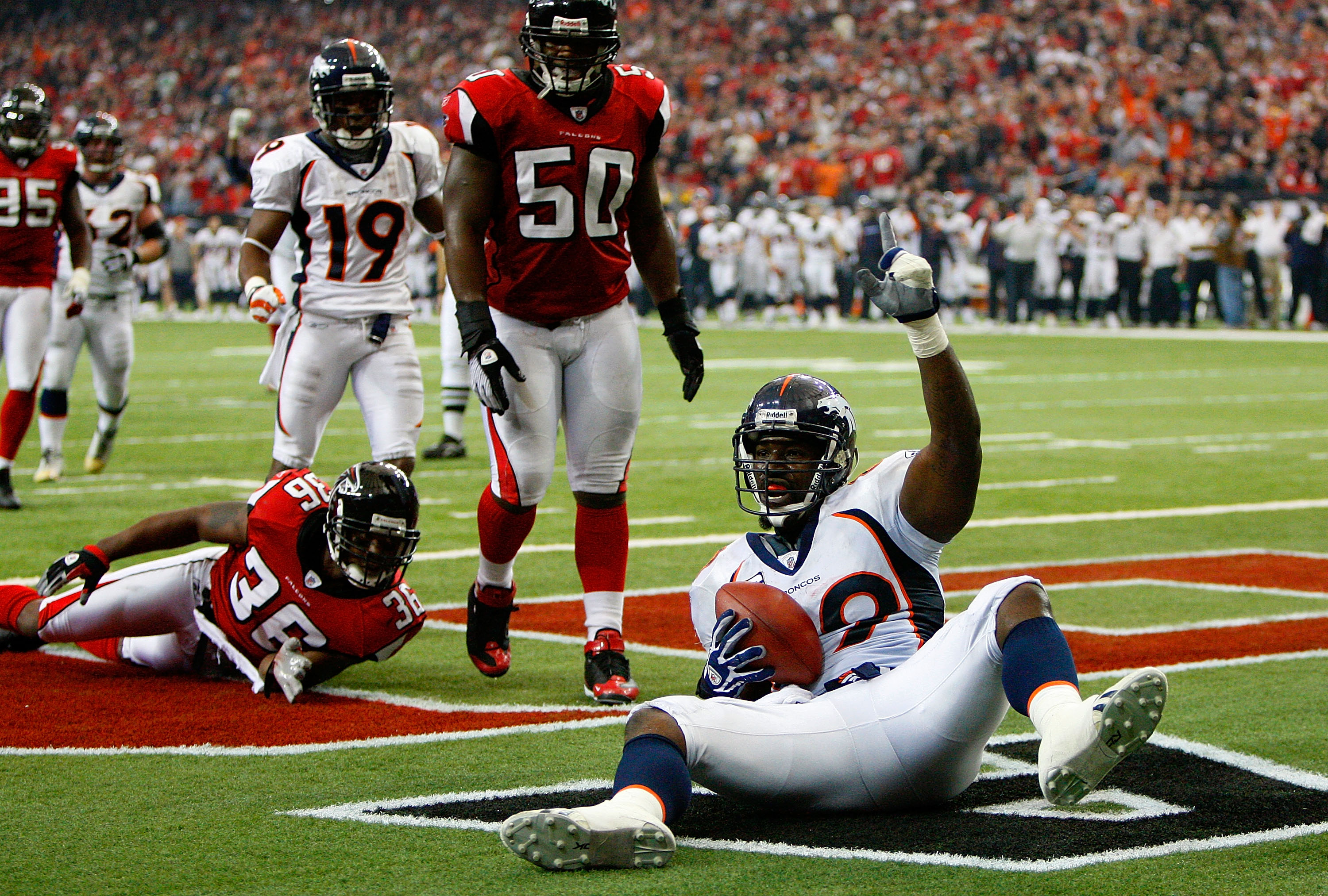ATLANTA - NOVEMBER 16:  Tight end Daniel Graham #89 of the Denver Broncos reacts after scoring the game-winning touchdown against Lawyer Milloy #36 and Curtis Lofton #50 of the Atlanta Falcons during the game at the Georgia Dome on November 16, 2008 in At