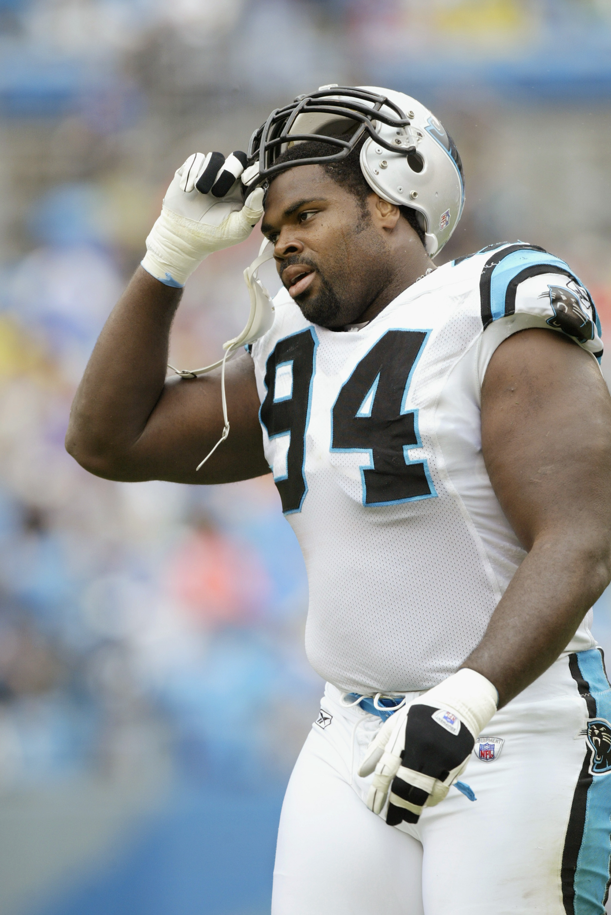 CHARLOTTE, NC - SEPTEMBER 15:  Defensive tackle Sean Gilbert #94 of the Carolina Panthers takes his helmet off before the NFL game against the Detroit Lions at Ericsson Stadium on September 15, 2002 in Charlotte, North Carolina. The Panthers won 31-7. (Ph