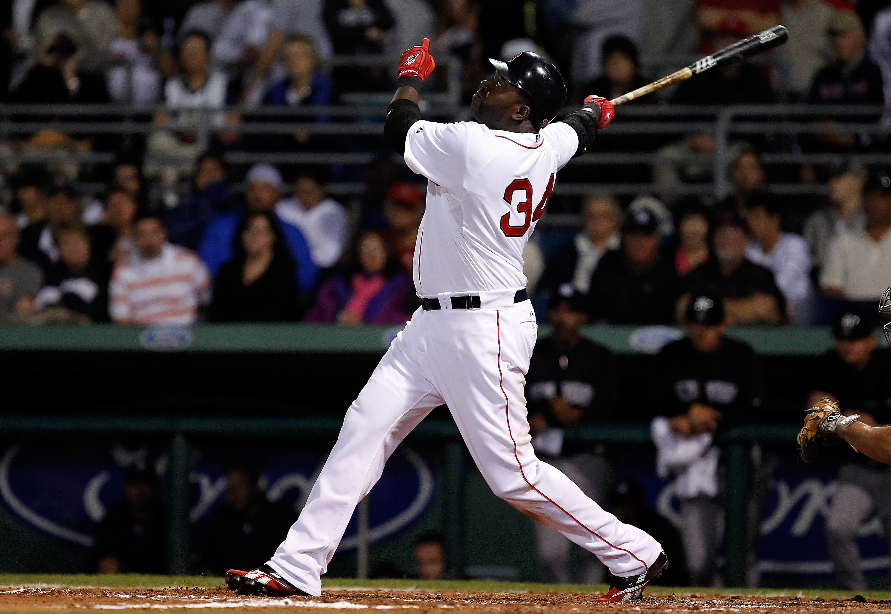 FORT MYERS, FL - MARCH 14:  Designated hitter David Ortiz #34 of the Boston Red Sox fouls off a pitch against the New York Yankees during a Grapefruit League Spring Training Game at City of Palms Park on March 14, 2011 in Fort Myers, Florida.  (Photo by J