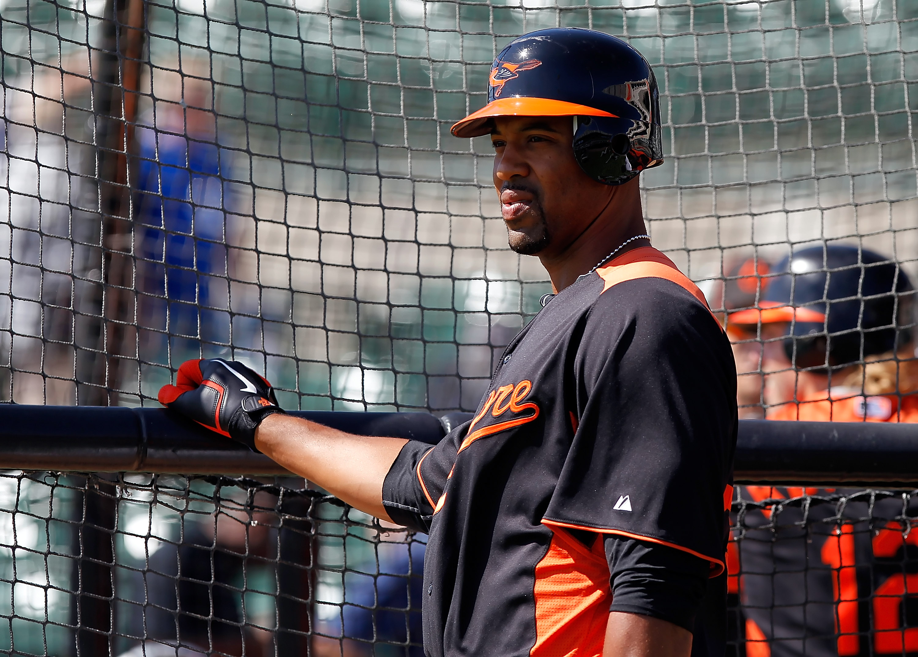 SARASOTA, FL - MARCH 03:  Infielder Derrek Lee #25 of the Baltimore Orioles takes batting practice just before the Grapefruit League Spring Training Game against the Minnesota Twins at Ed Smith Stadium on March 3, 2011 in Sarasota, Florida.  (Photo by J.