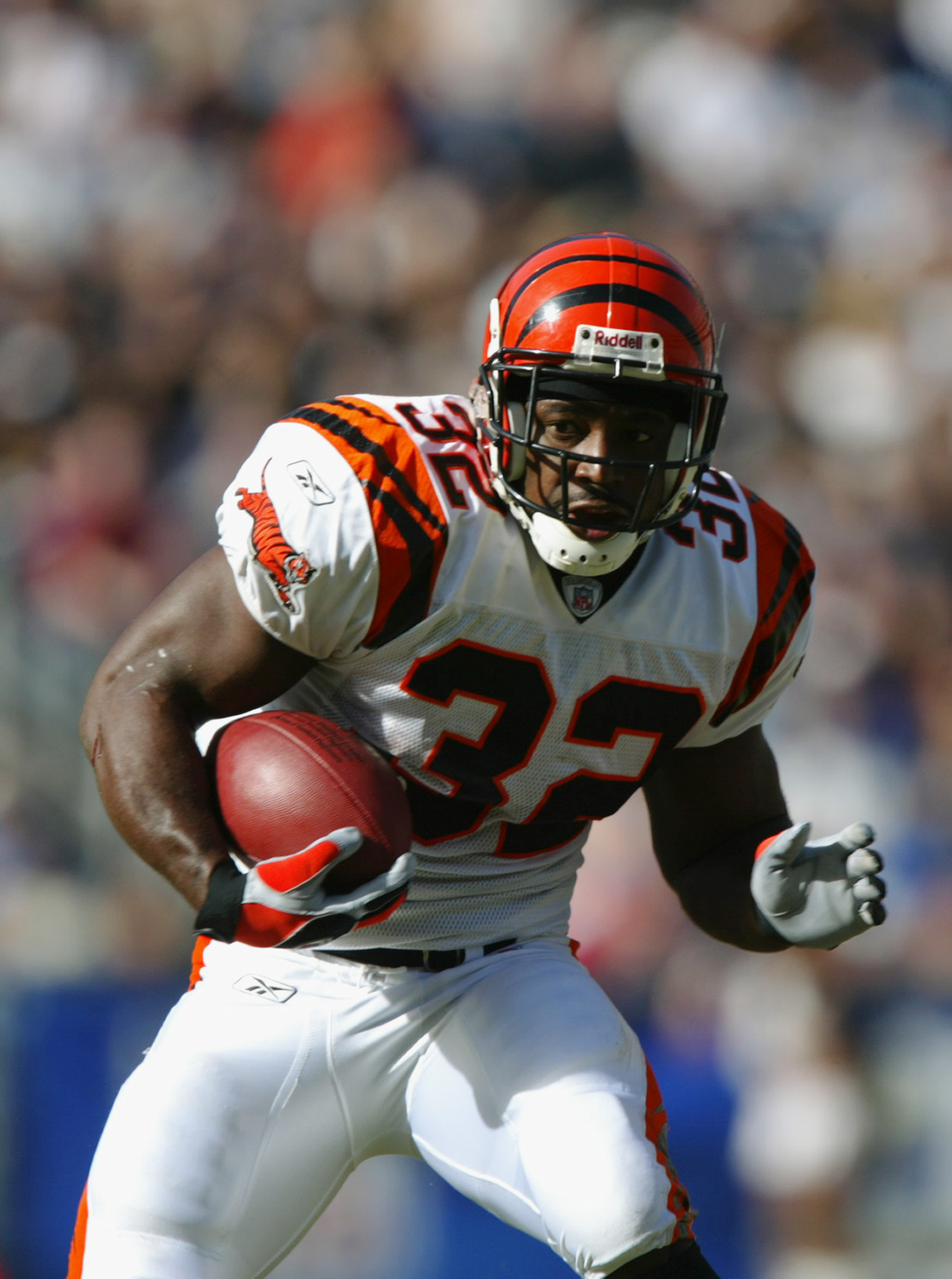 SAN DIEGO - NOVEMBER 23:  Running back Rudi Johnson #32 of the Cincinnati Bengals runs the ball against the San Diego Chargers on November 23, 2003 at Qualcomm Stadium in San Diego, California.  The Bengals defeated the Chargers 34-27. (Photo by Donald Mi