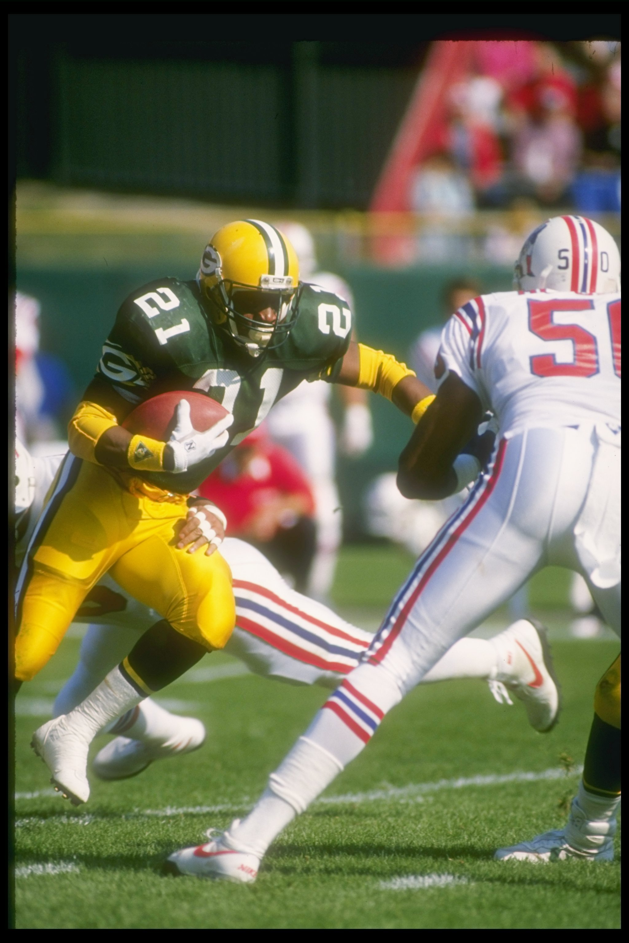 9 Oct 1988:  Running back Brent Fullwood of the Green Bay Packers (left) moves the ball during a game against the New England Patriots at Lambeau Field in Green Bay, Wisconsin.  The Packers won the game, 45-3. Mandatory Credit: Jonathan Daniel  /Allsport
