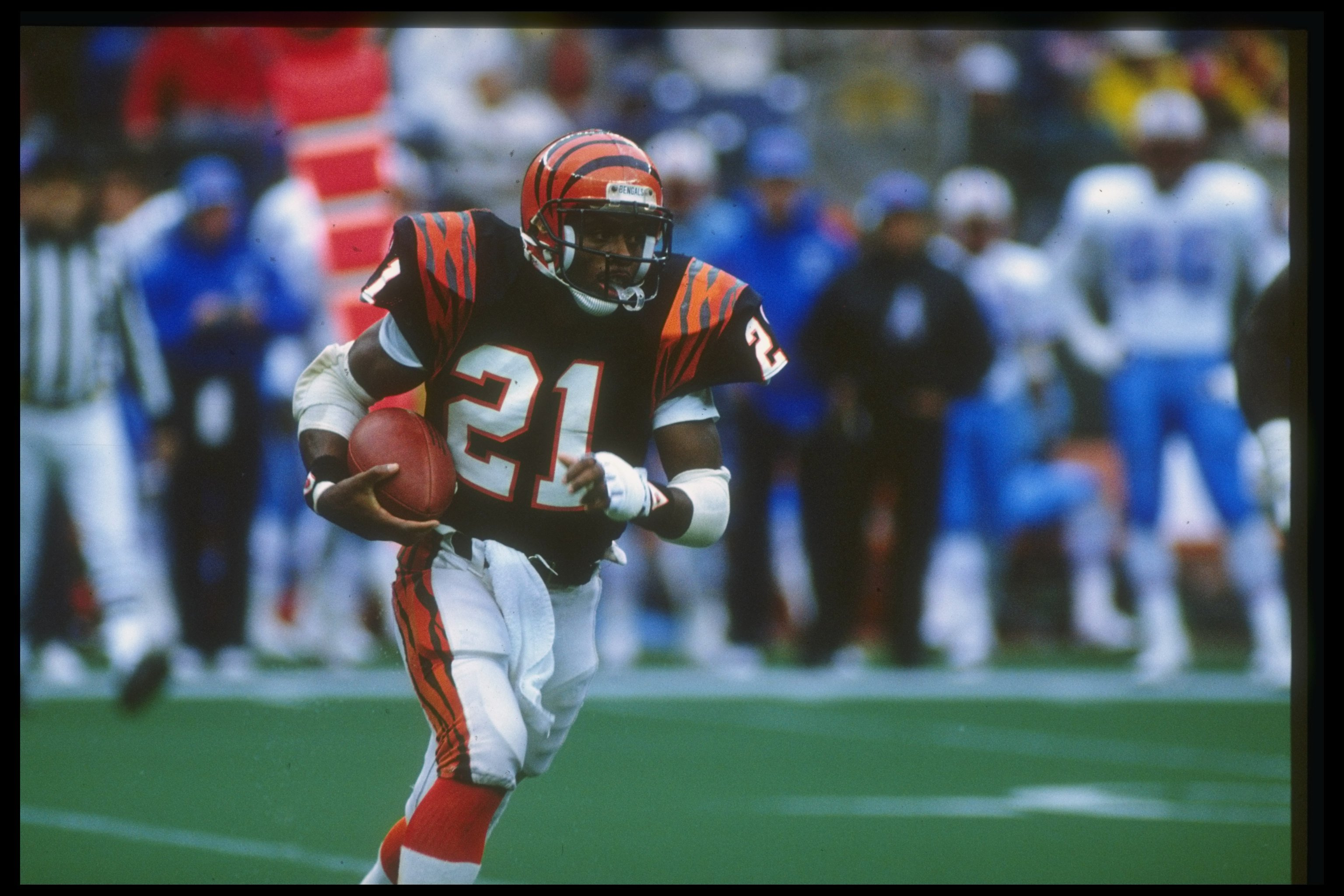 23 Oct 1988: Running back James Brooks of the Cincinnati Bengals moves the ball during a game against the Houston Oilers at Riverfront Stadium in Cincinnati, Ohio. The Bengals won the game, 44-21.
