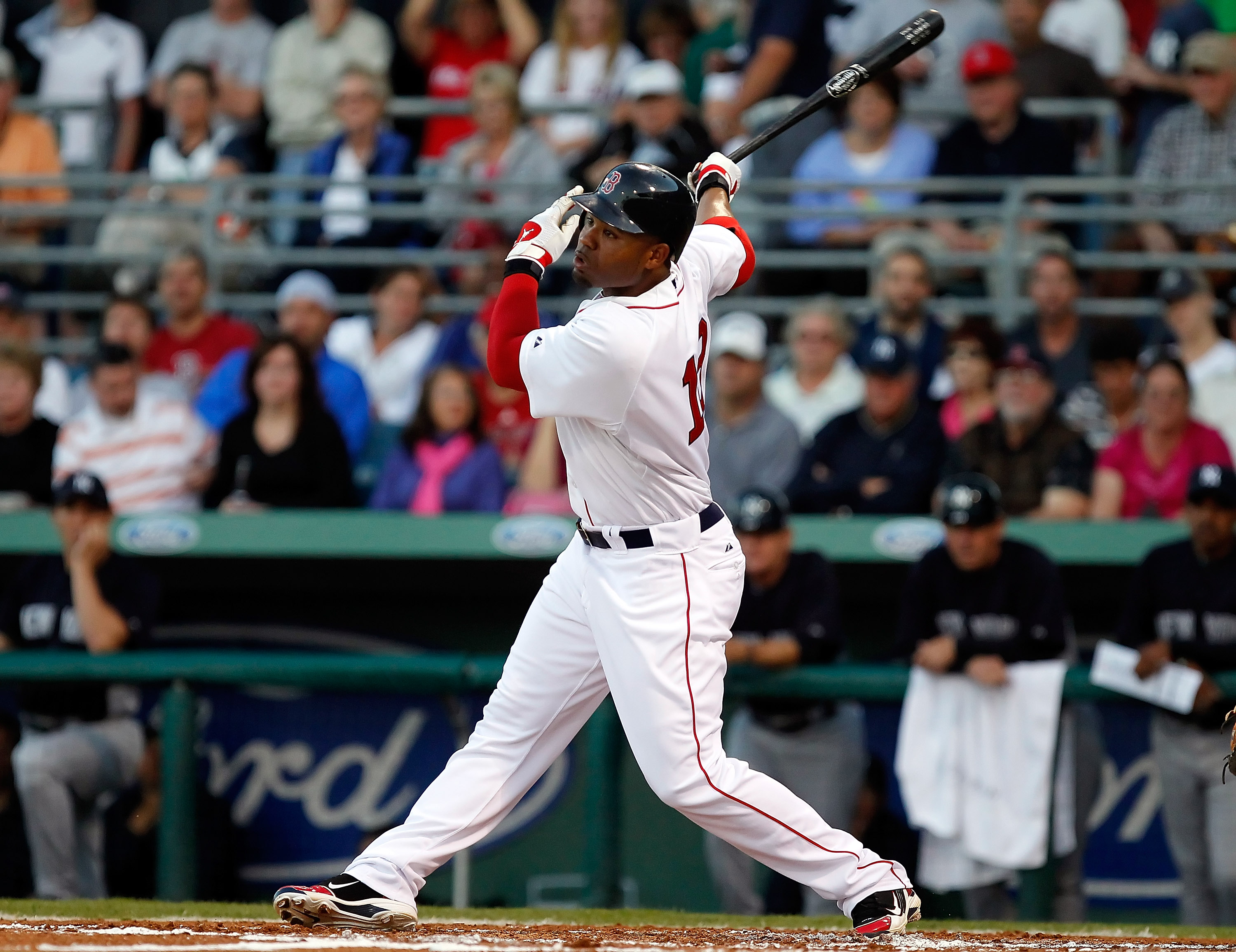 FORT MYERS, FL - MARCH 14:  Outfielder Carl Crawford #13 of the Boston Red Sox fouls off a pitch against the New York Yankees during a Grapefruit League Spring Training Game at City of Palms Park on March 14, 2011 in Fort Myers, Florida.  (Photo by J. Mer