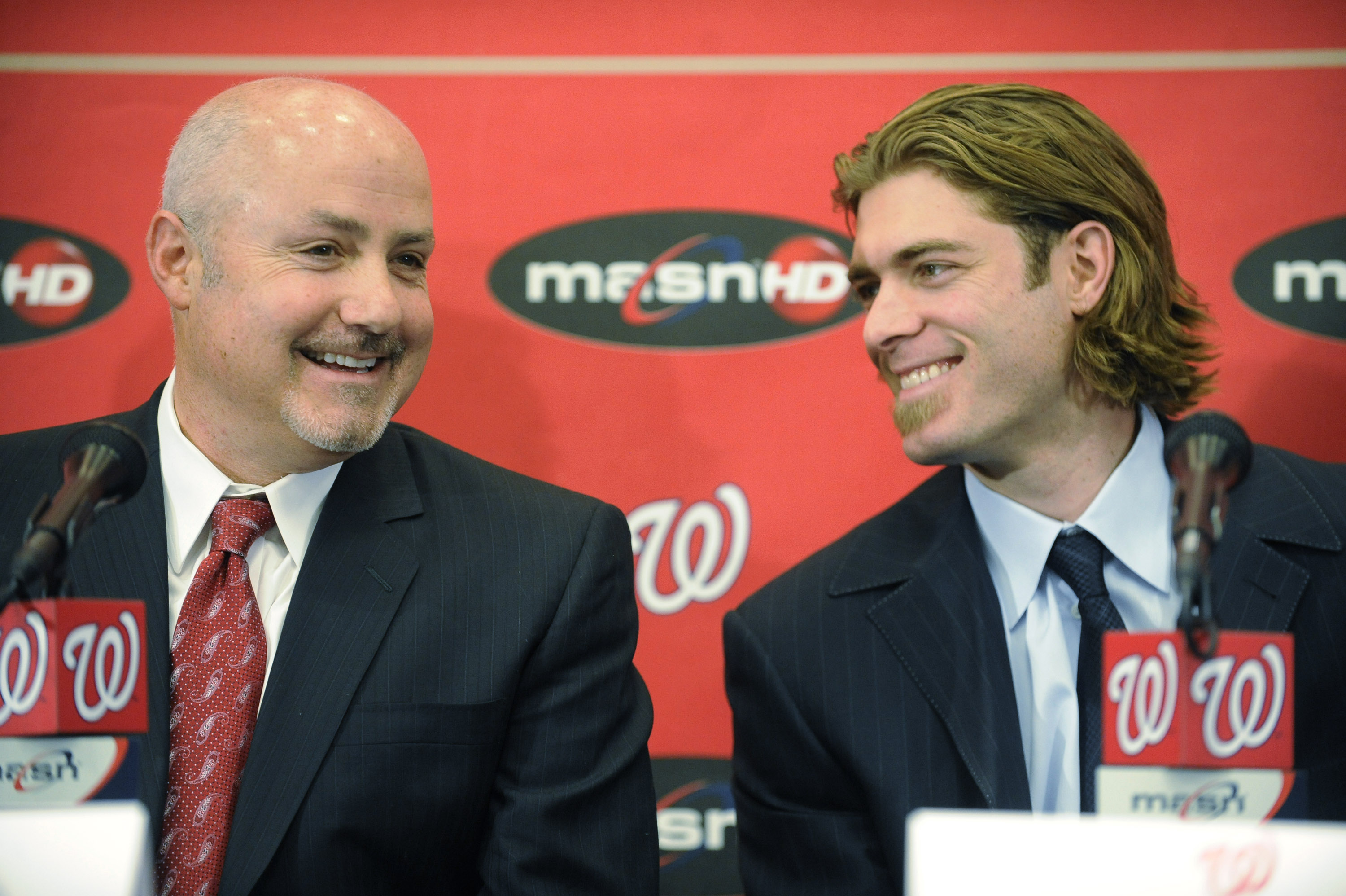 WASHINGTON, DC - DECEMBER 15:  Executive Vice President of Baseball Operations and General Manager Mike Rizzo introduces Jayson Werth #28  of the Washington Nationals to the media on December 15, 2010 at Nationals Park in Washington, DC.   (Photo by Mitch