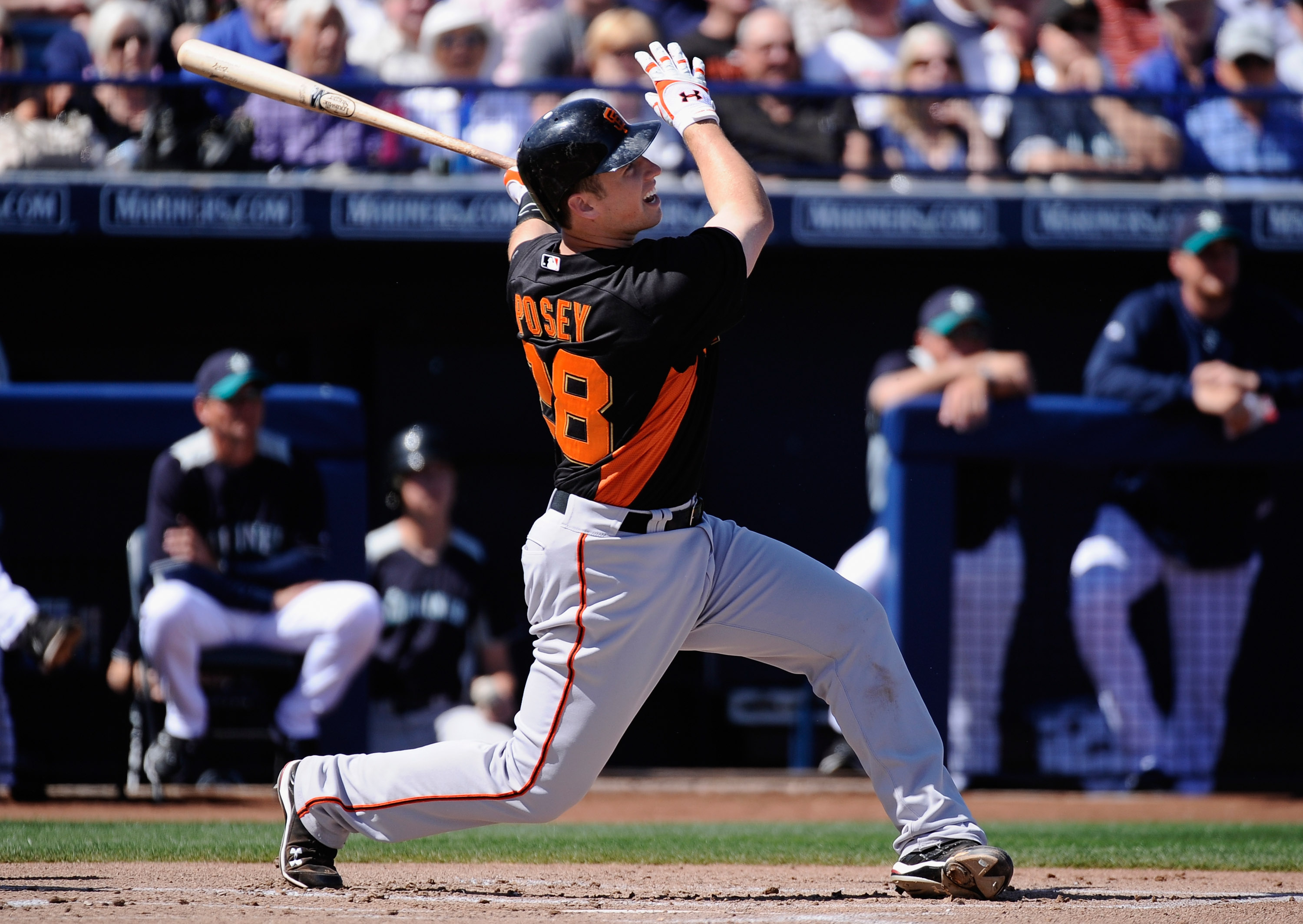 PEORIA, AZ - MARCH 08:  Buster Posey #28 San Francisco Giants swings at a pitch against the Seattle Mariners during the spring training baseball game against at Peoria Stadium on March 8, 2011 in Peoria, Arizona.  (Photo by Kevork Djansezian/Getty Images)
