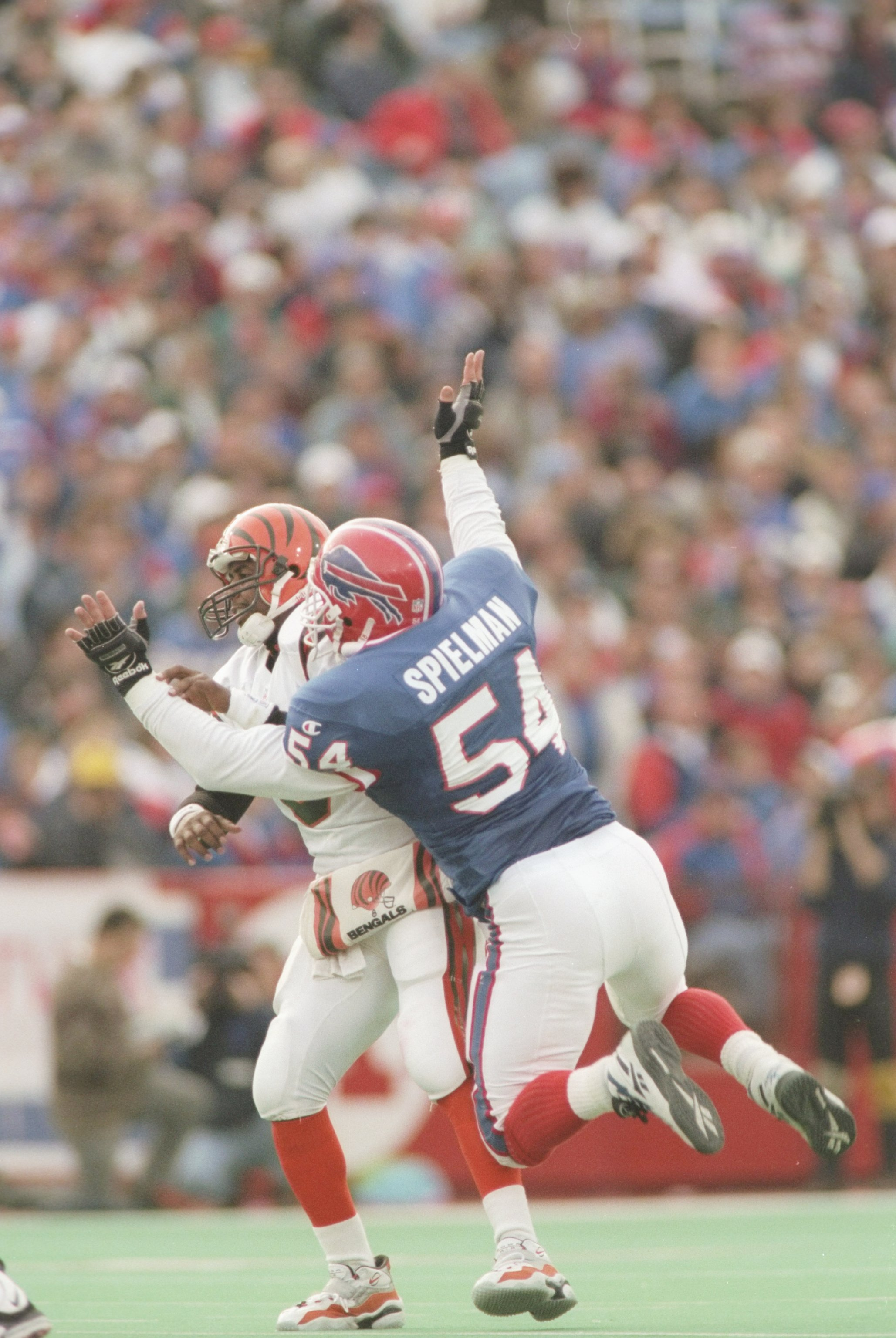 17 Nov 1996: Quarterback Jeff Blake of the Cincinnati Bengals is sacked by linebacker Chris Spielman of the Buffalo Bills during the Bengals 31-17 loss to the Buffalo Bills at Rich Stadium in Orchard Park, New York.