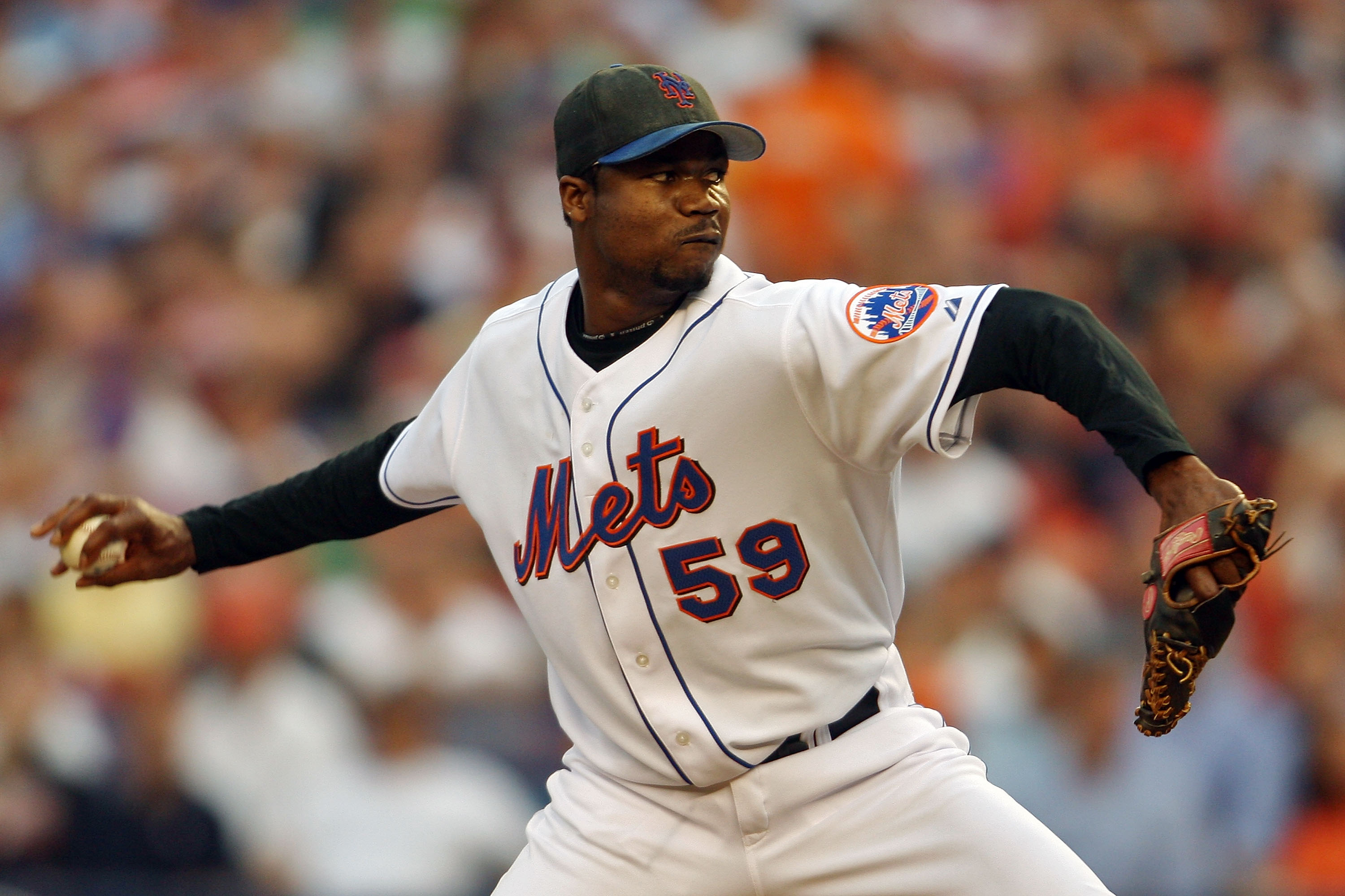 NEW YORK - OCTOBER 04:  Guillermo Mota #59 of the New York Mets pitches against the Los Angeles Dodgers during game one of the National League Division Series at Shea Stadium on October 4, 2006 in the Flushing neighborhood of Queens borough of New York Ci