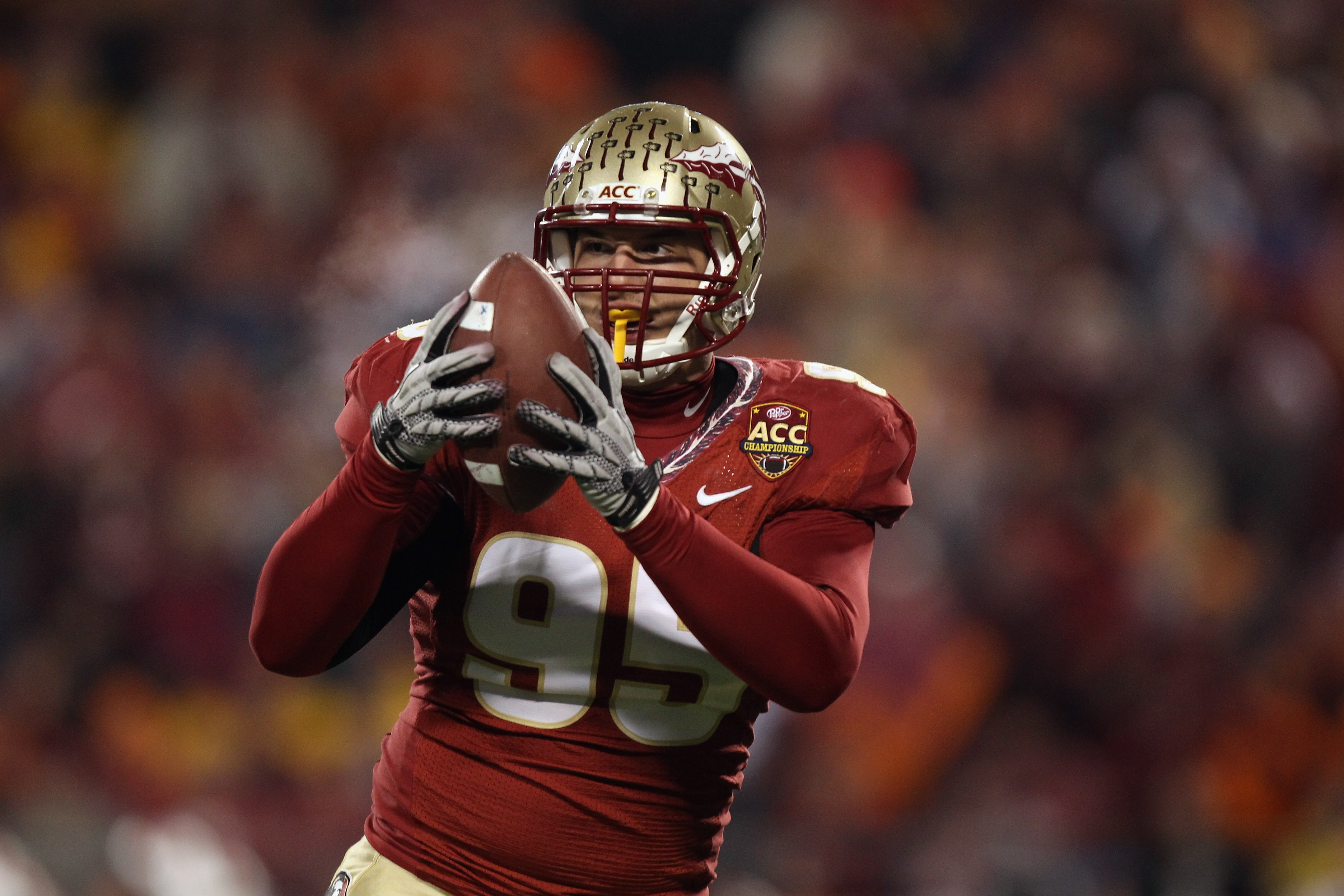 CHARLOTTE, NC - DECEMBER 04:  Bjoern Werner #95 of the Florida State Seminoles against the Virginia Tech Hokies during their game at Bank of America Stadium on December 4, 2010 in Charlotte, North Carolina.  (Photo by Streeter Lecka/Getty Images)