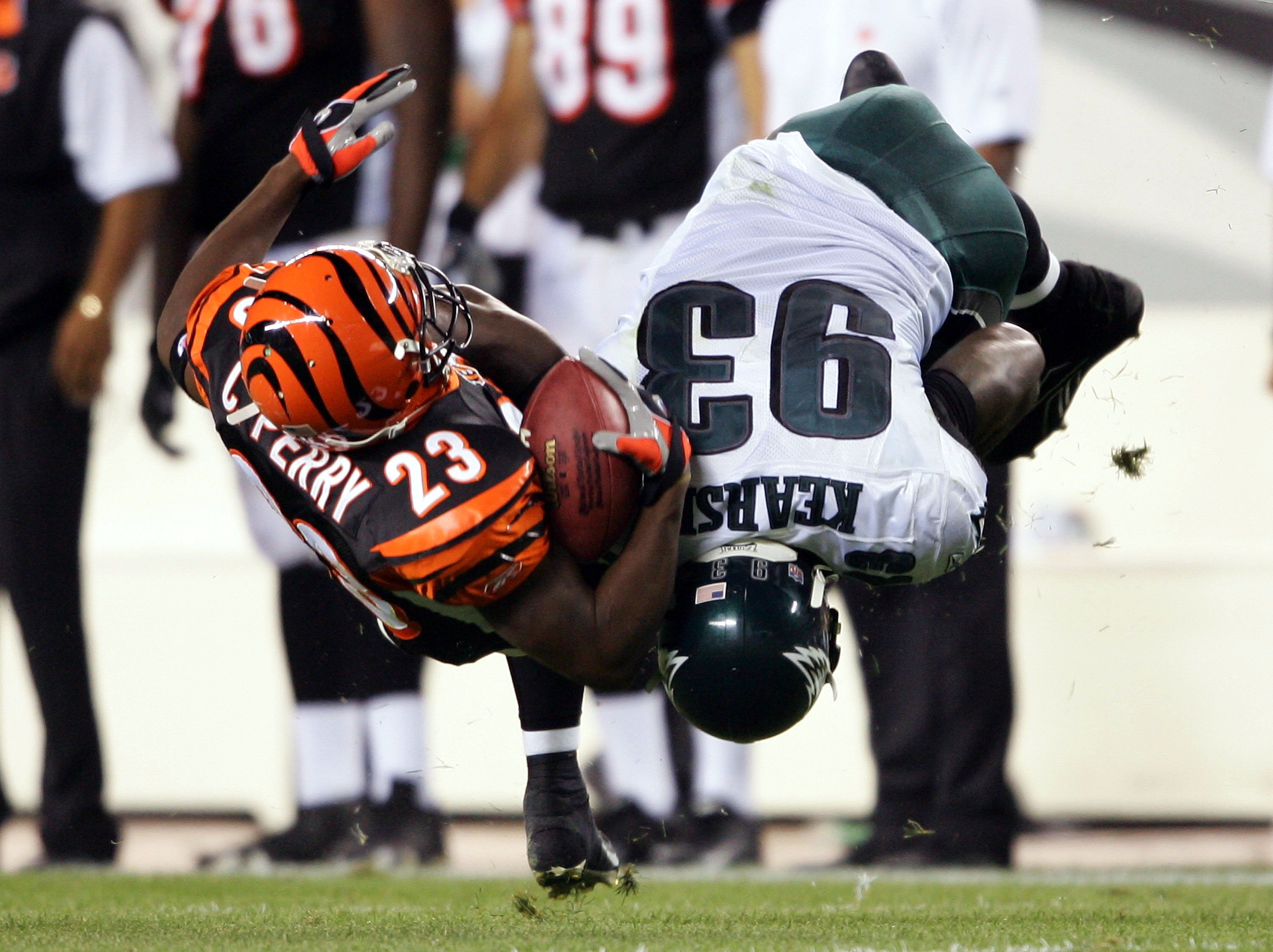 PHILADELPHIA - AUGUST 26:  Defensive end Jevon Kearse #93 of the Philadelphia Eagles knocks over running back Chris Perry #23 of the Cincinnati Bengals during the first half of their preseason game on August 26, 2005 at Lincoln Financial Field in Philadel