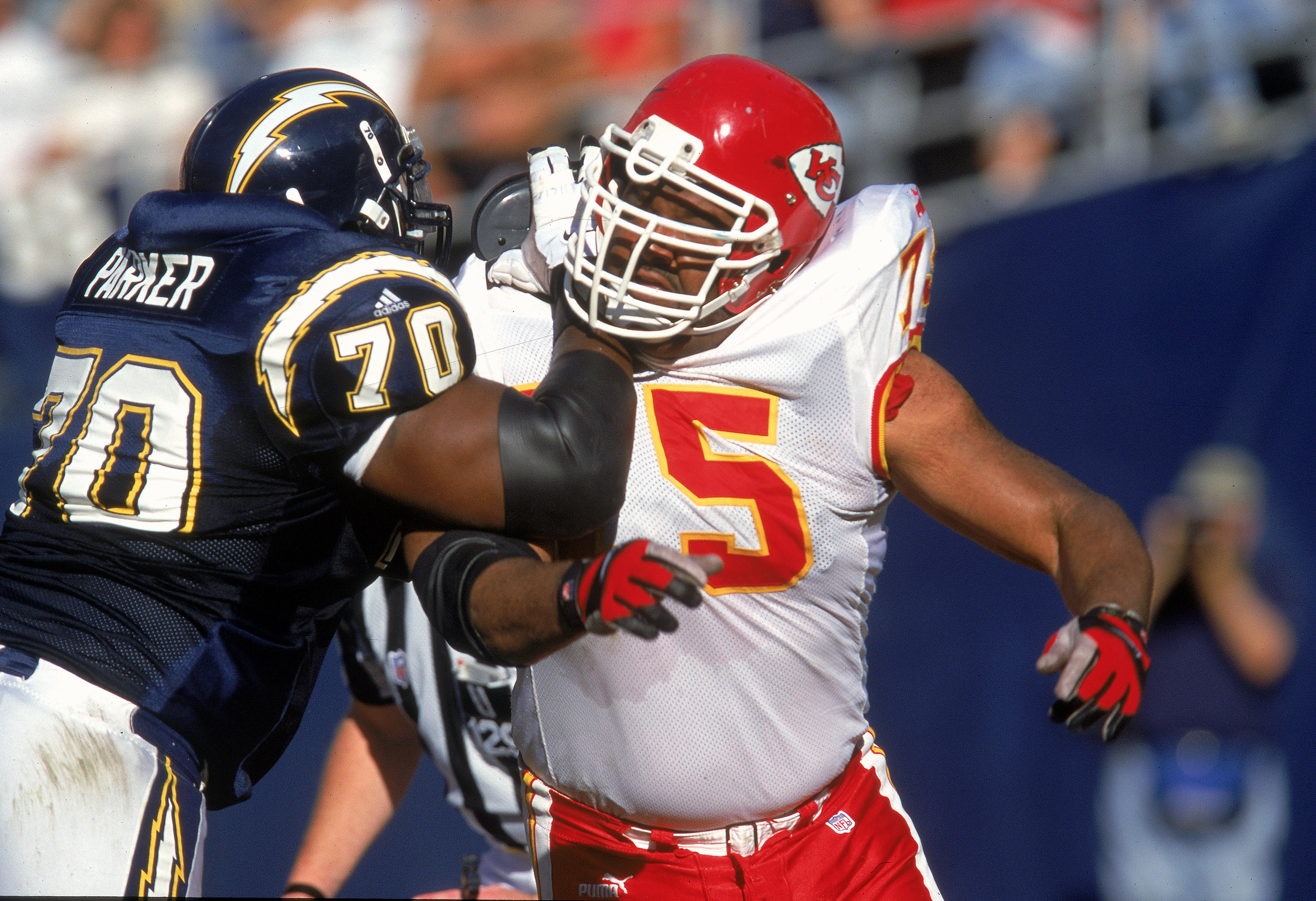 26 Nov 2000: Chester McGlockton #75 of the Kansas City Chiefs is blocked by Vaughn Parker #70 of the San Diego Chargers at the Qualcomm Stadium in San Diego, California. The Chargers defeated the Chiefs 17-16.Mandatory Credit: Stephen Dunn  /Allsport