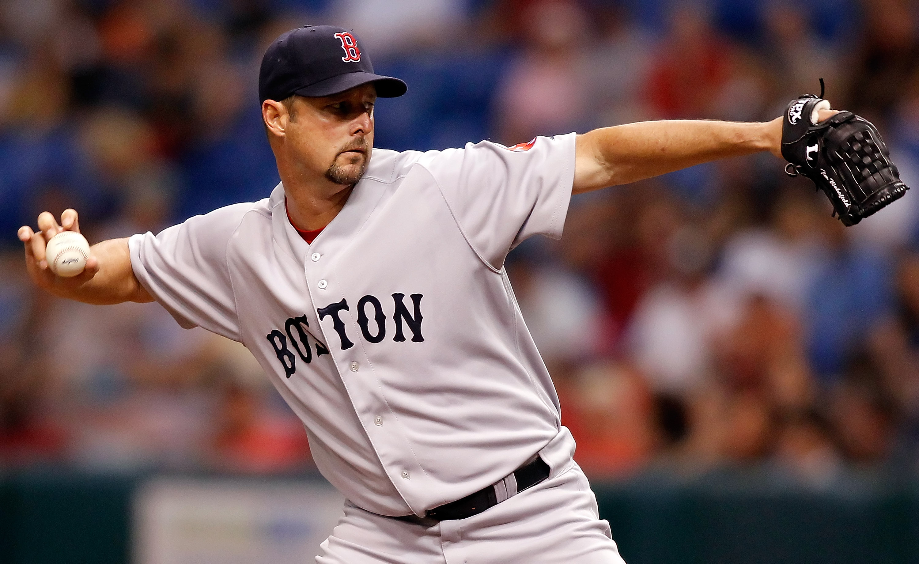 ST. PETERSBURG - JULY 07:  Pitcher Tim Wakefield #49 of the Boston Red Sox pitches against the Tampa Bay Rays during the game at Tropicana Field on July 7, 2010 in St. Petersburg, Florida.  (Photo by J. Meric/Getty Images)