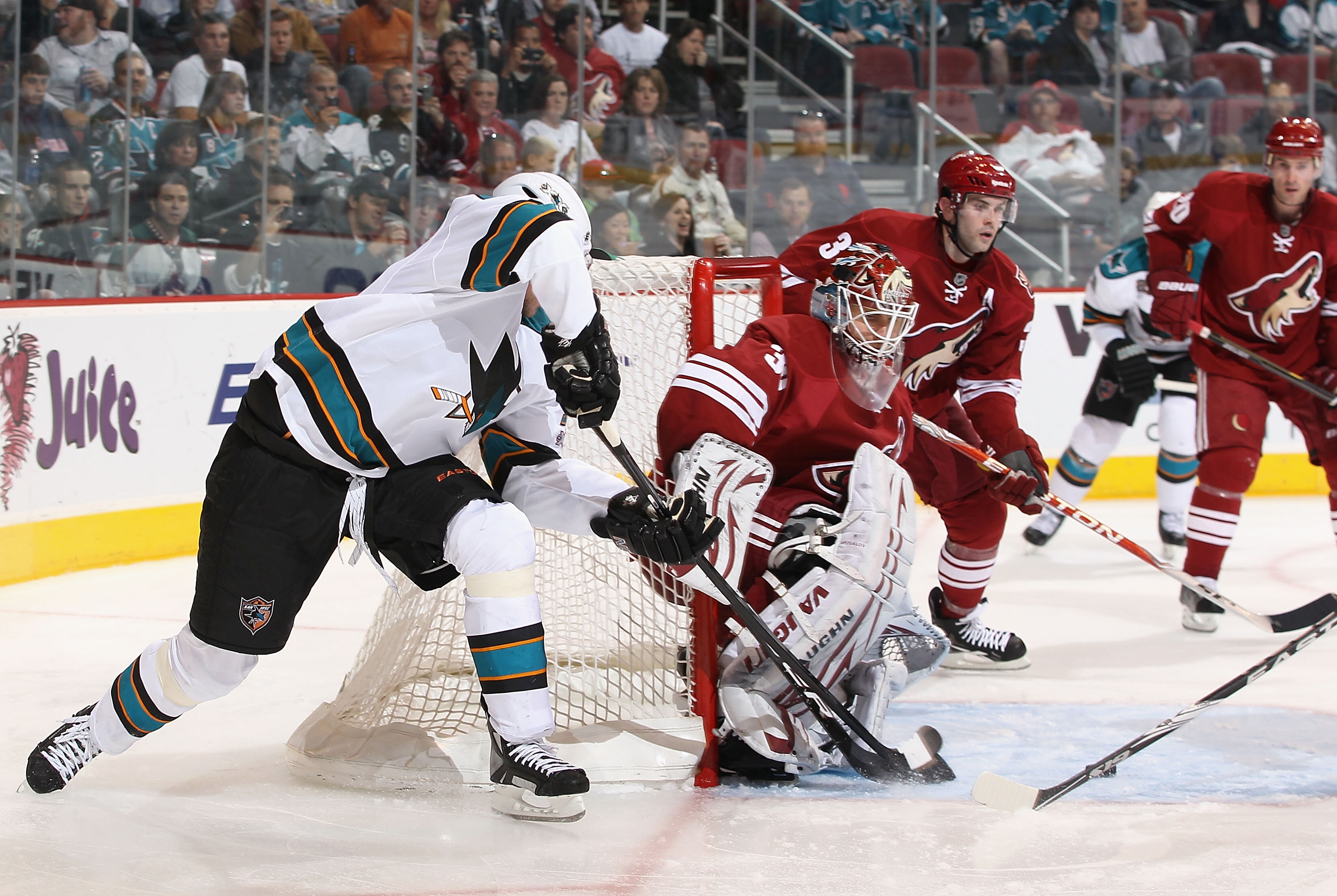 GLENDALE, AZ - MARCH 26:  Goaltender Ilya Bryzgalov #30 of the Phoenix Coyotes makes a pad save on the shot from Dany Heatley #15 of the San Jose Sharks during the NHL game at Jobing.com Arena on March 26, 2011 in Glendale, Arizona. The Sharks defeated th