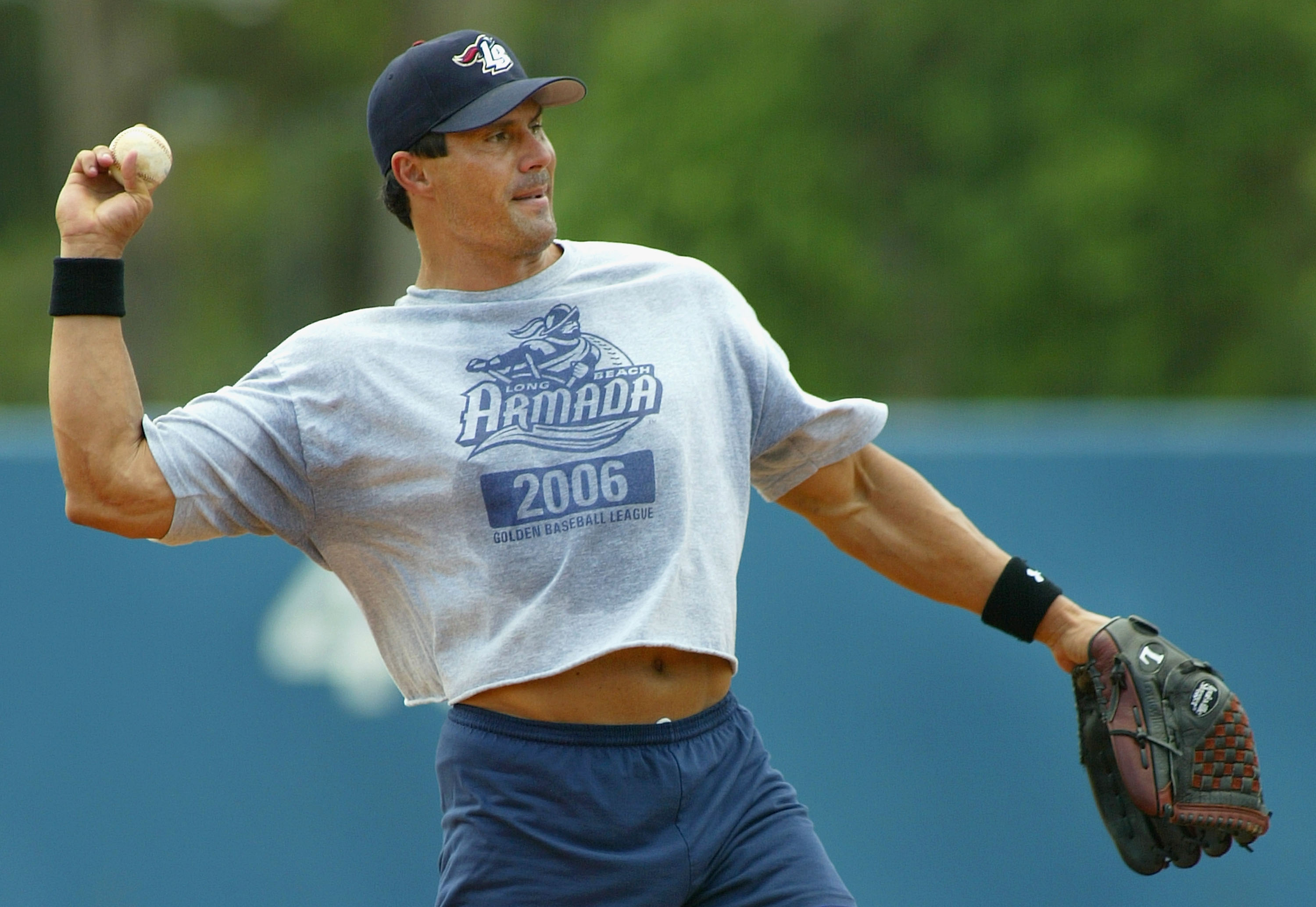 LONG BEACH, CA - JULY 16:  Jose Canseco #33 of the Long Beach Armada throws the ball in warm ups before the Golden Baseball League game against the Fullerton Flyers on July 16, 2006 at Blair Field in Long Beach, California.  (Photo By Christian Petersen/G