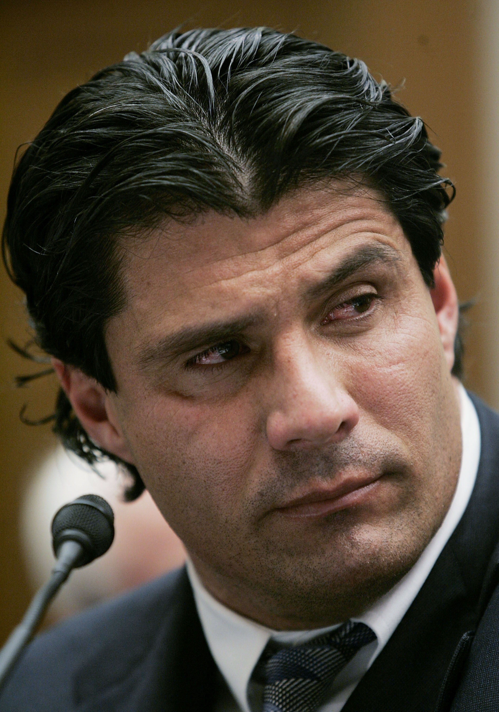 WASHINGTON - MARCH 17:  Former Major League Baseball player Jose Canseco listens to testimony during a House Committe session investigating Major League Baseball's effort to eradicate steroid use on Capital Hill March 17, 2005 in Washington, DC. Major Lea