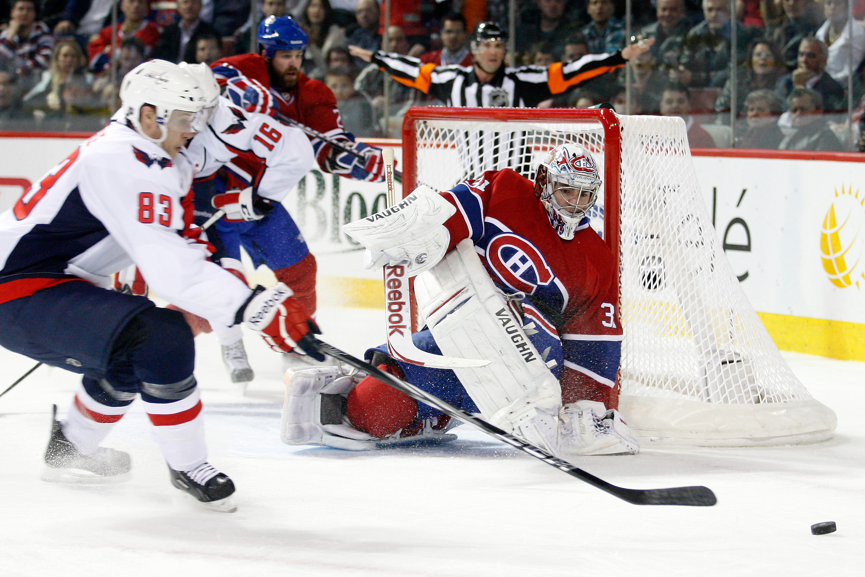 MONTREAL, CANADA - MARCH 15:  Goalie Carey Price #31 of the Montreal Canadiens watches a puck rebound  in front of Jay Beagle #83 of the Washington Capitals during the NHL game at the Bell Centre on March 15, 2011 in Montreal, Quebec, Canada.  The Capital