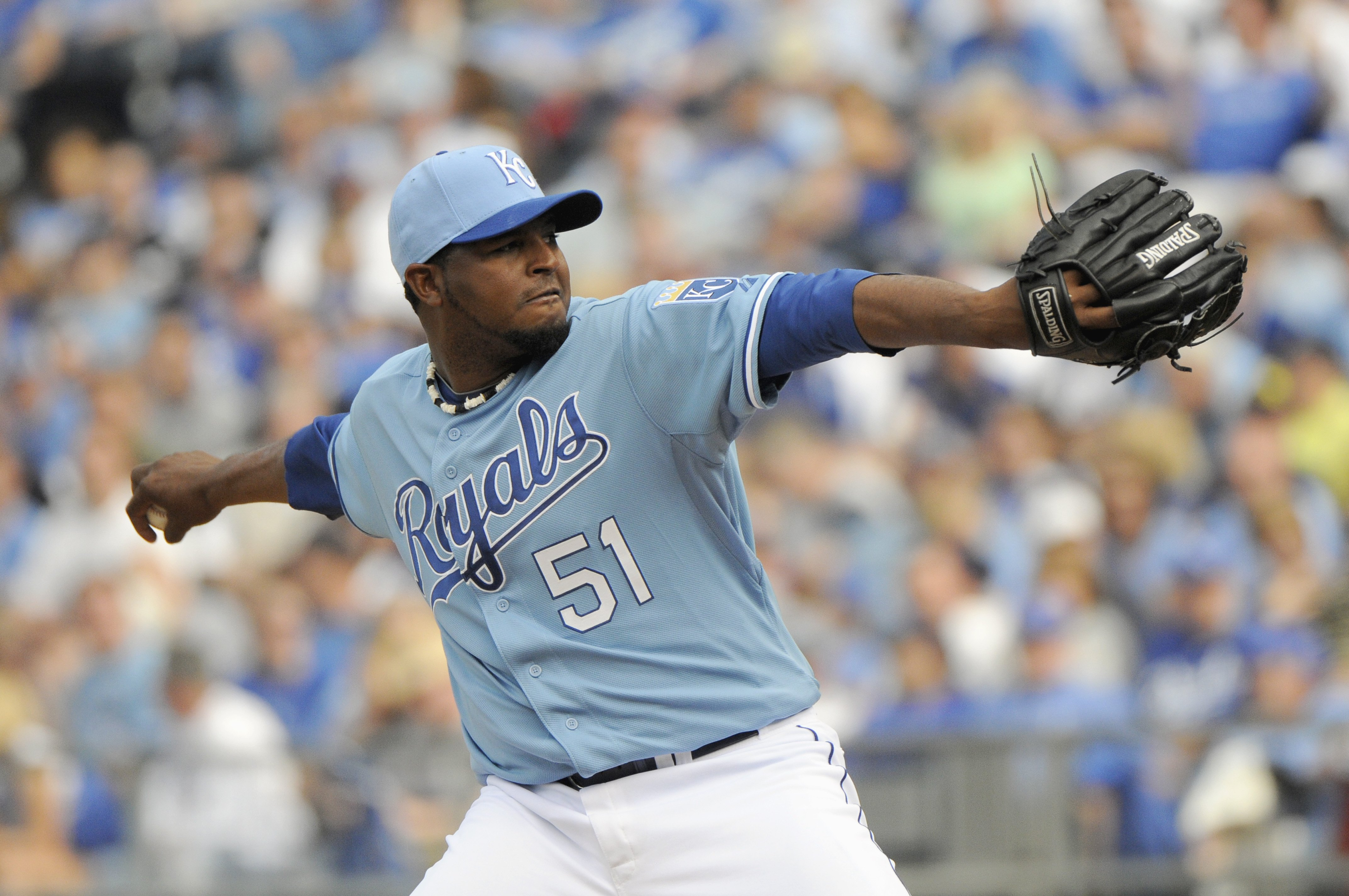 KANSAS CITY, MO - APRIL 05:  Robinson Tejeda #51 of the Kansas City Royals delivers a pitch during the season opener game against the Detroit Tigers on April 5, 2010 at Kauffman Stadium in Kansas City, Missouri. (Photo by G. Newman Lowrance/Getty Images)