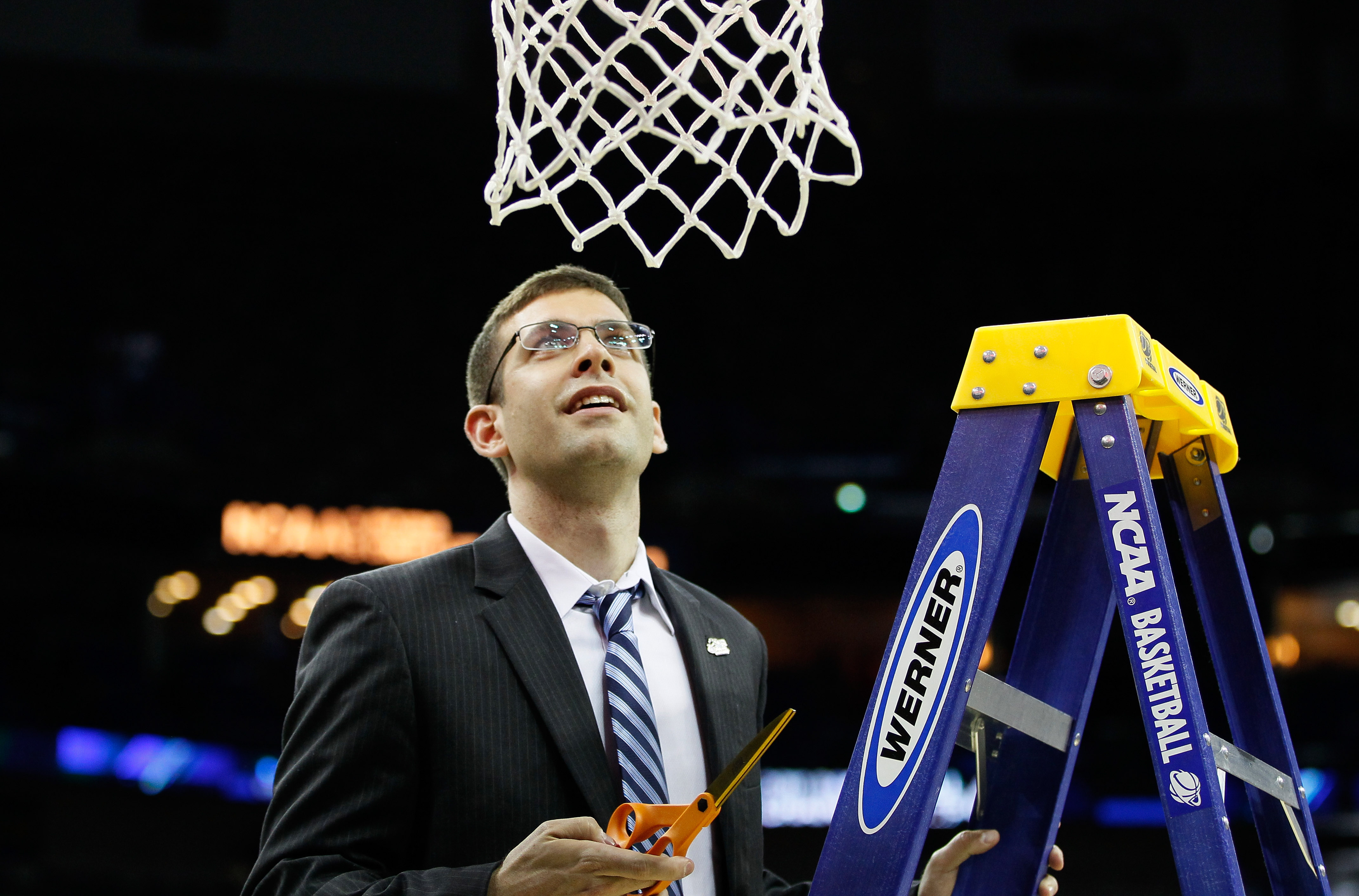 NEW ORLEANS, LA - MARCH 26:  Head coach Brad Stevens of the Butler Bulldogs celebrates defeateing the Florida Gators 74 to 71 in overtime by cuttin down part of the net during the Southeast regional final of the 2011 NCAA men's basketball tournament at Ne