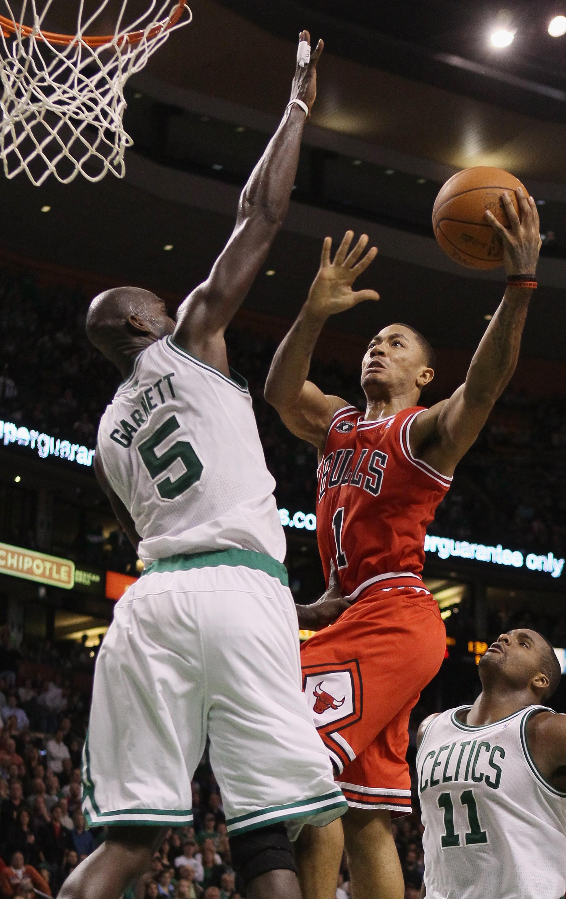 BOSTON - NOVEMBER 05:  Derrick Rose #1 of the Chicago Bulls takes a shot as Kevin Garnett #5 of the Boston Celtics on November 5, 2010 at the TD Garden in Boston, Massachusetts. The Celtics defeated the Bulls 110-105 in overtime. NOTE TO USER: User expres