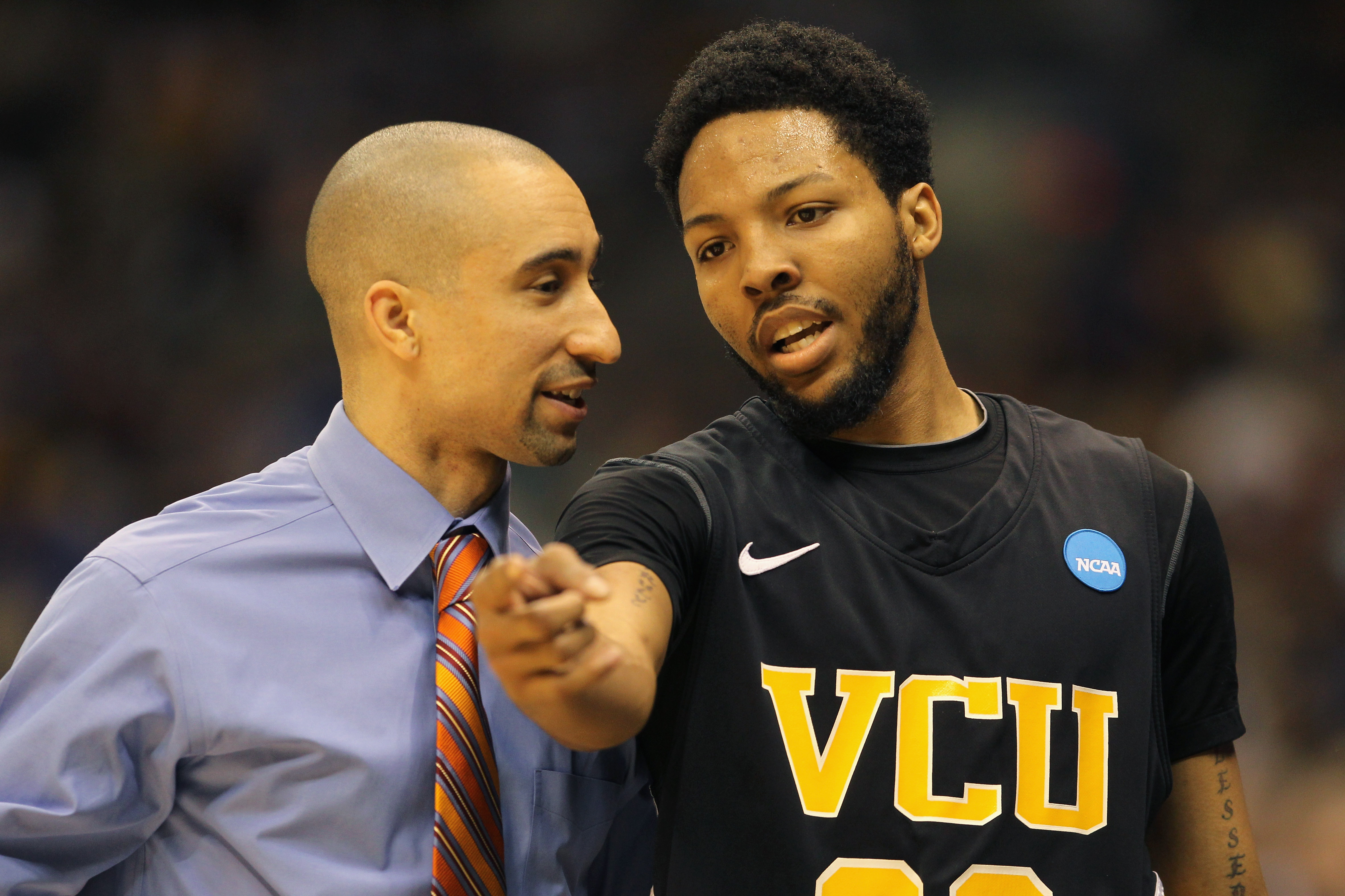 SAN ANTONIO, TX - MARCH 27:  Head coach Shaka Smart and Brandon Rozzell #32 of the Virginia Commonwealth Rams talk during the southwest regional final of the 2011 NCAA men's basketball tournament against the Kansas Jayhawks at the Alamodome on March 27, 2