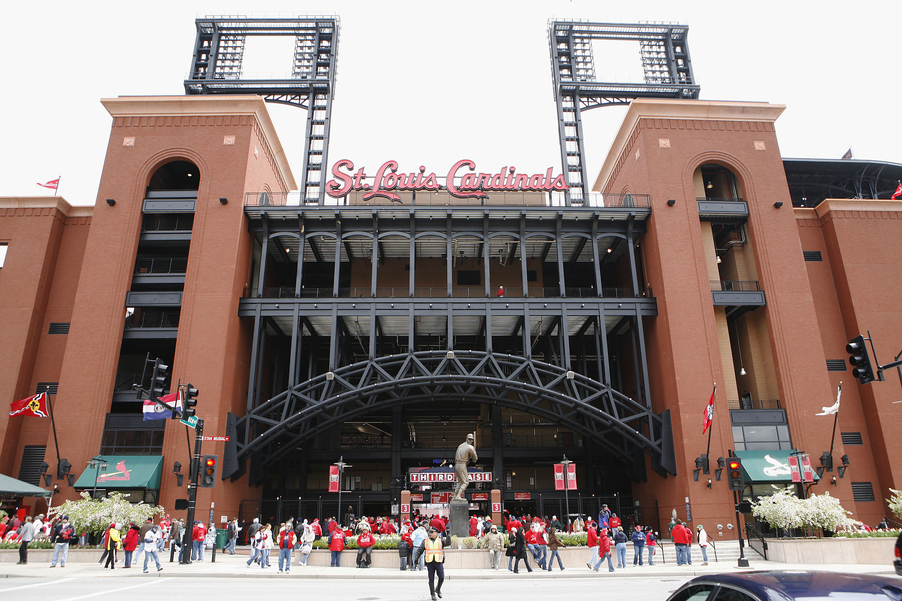 ST. LOUIS, MISSOURI - APRIL 6: Fans stand outside Busch Stadium prior to the opening day game between the St. Louis Cardinals and the Pittsburgh Pirates at Busch Stadium April 6, 2009 in St. Louis, Missouri.  (Photo by Dilip Vishwanat/Getty Images)
