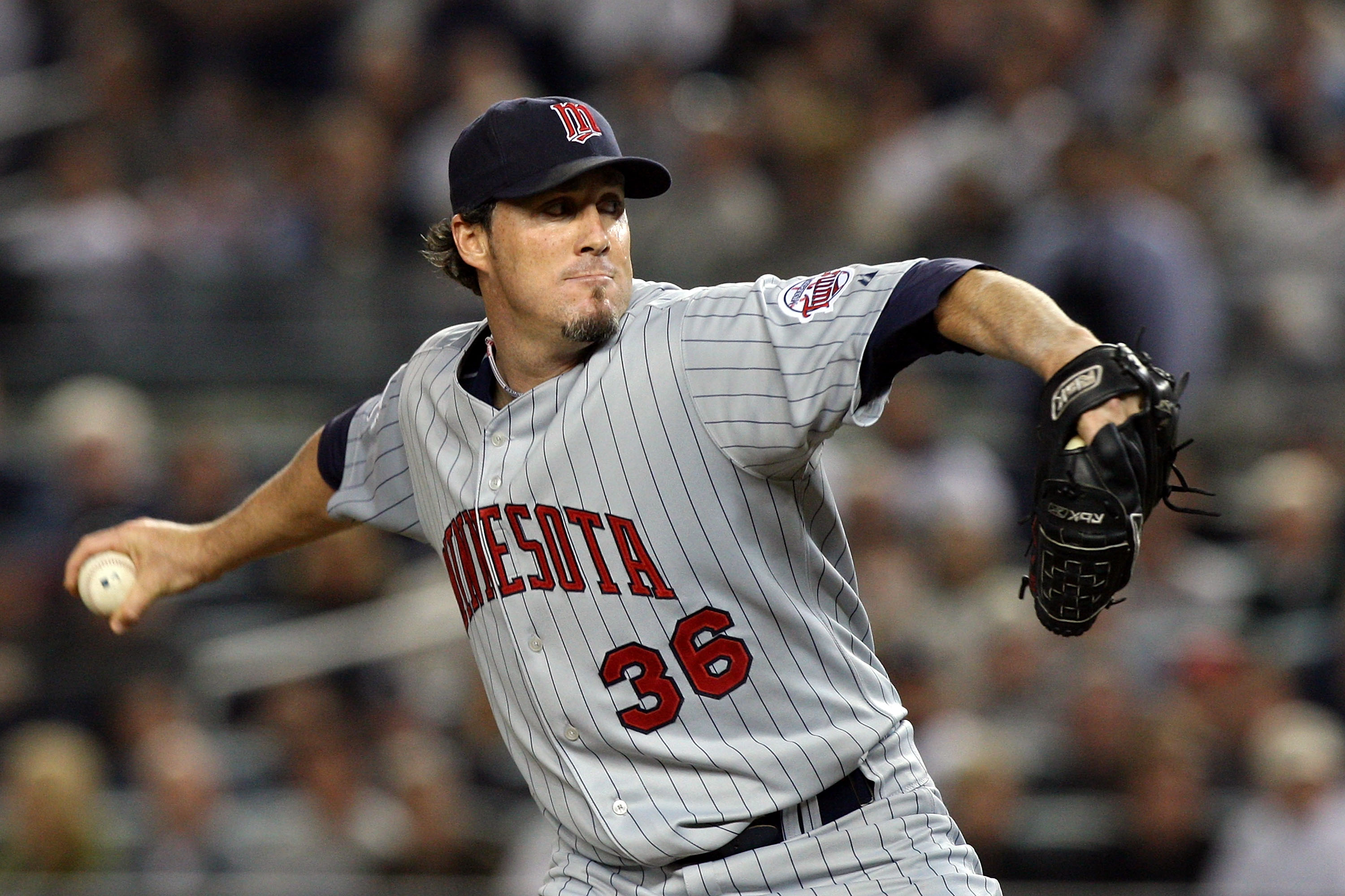NEW YORK - OCTOBER 09:  Joe Nathan #36 of the Minnesota Twins pitches against the New York Yankees in Game Two of the ALDS during the 2009 MLB Playoffs at Yankee Stadium on October 9, 2009 in the Bronx borough of New York City.  (Photo by Jim McIsaac/Gett