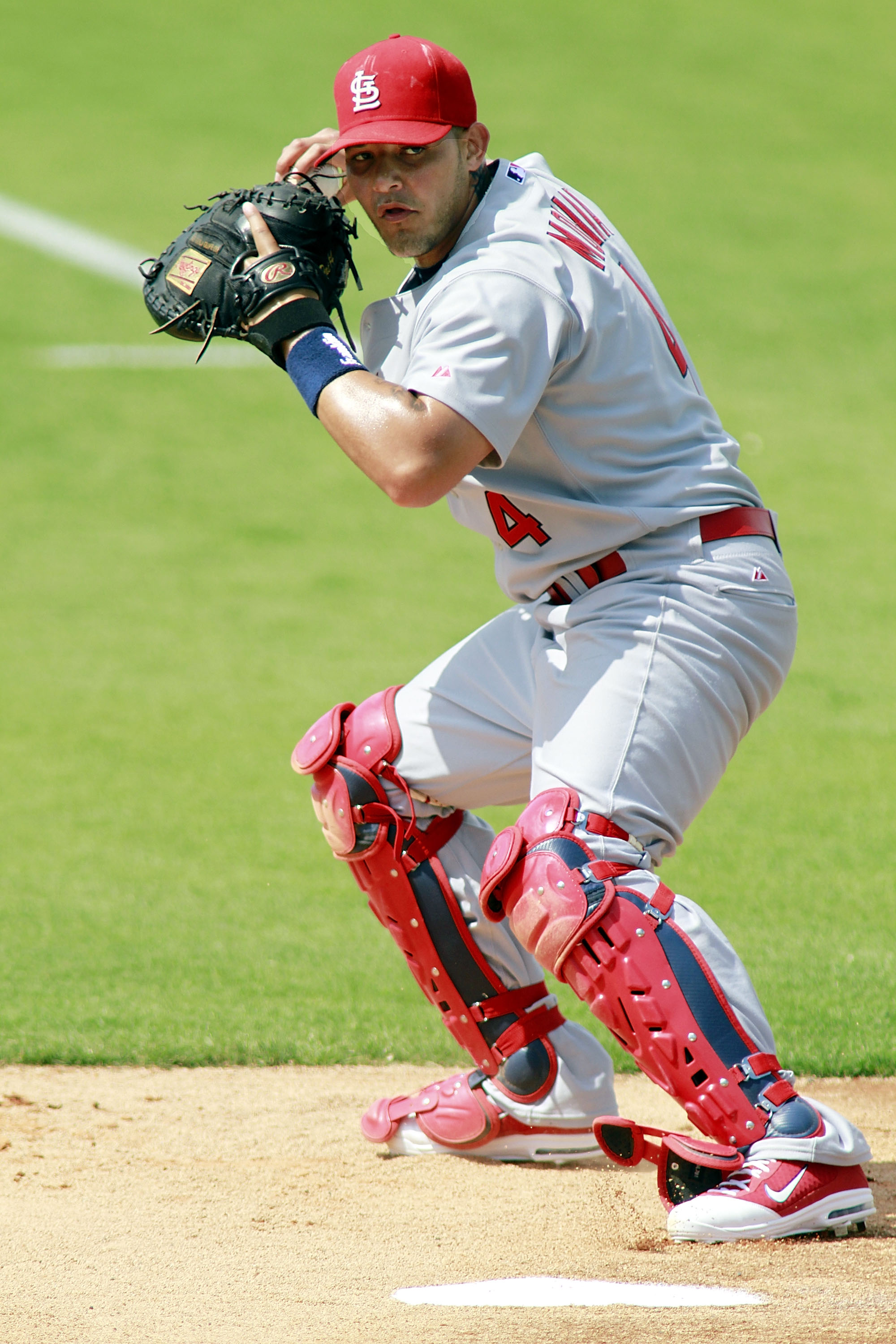 JUPITER, FL - MARCH 01:  Catcher Yadier Molina of the St. Louis Cardinals prepares for the Florida Marlins at Roger Dean Stadium on March 1, 2011 in Jupiter, Florida.  (Photo by Marc Serota/Getty Images)