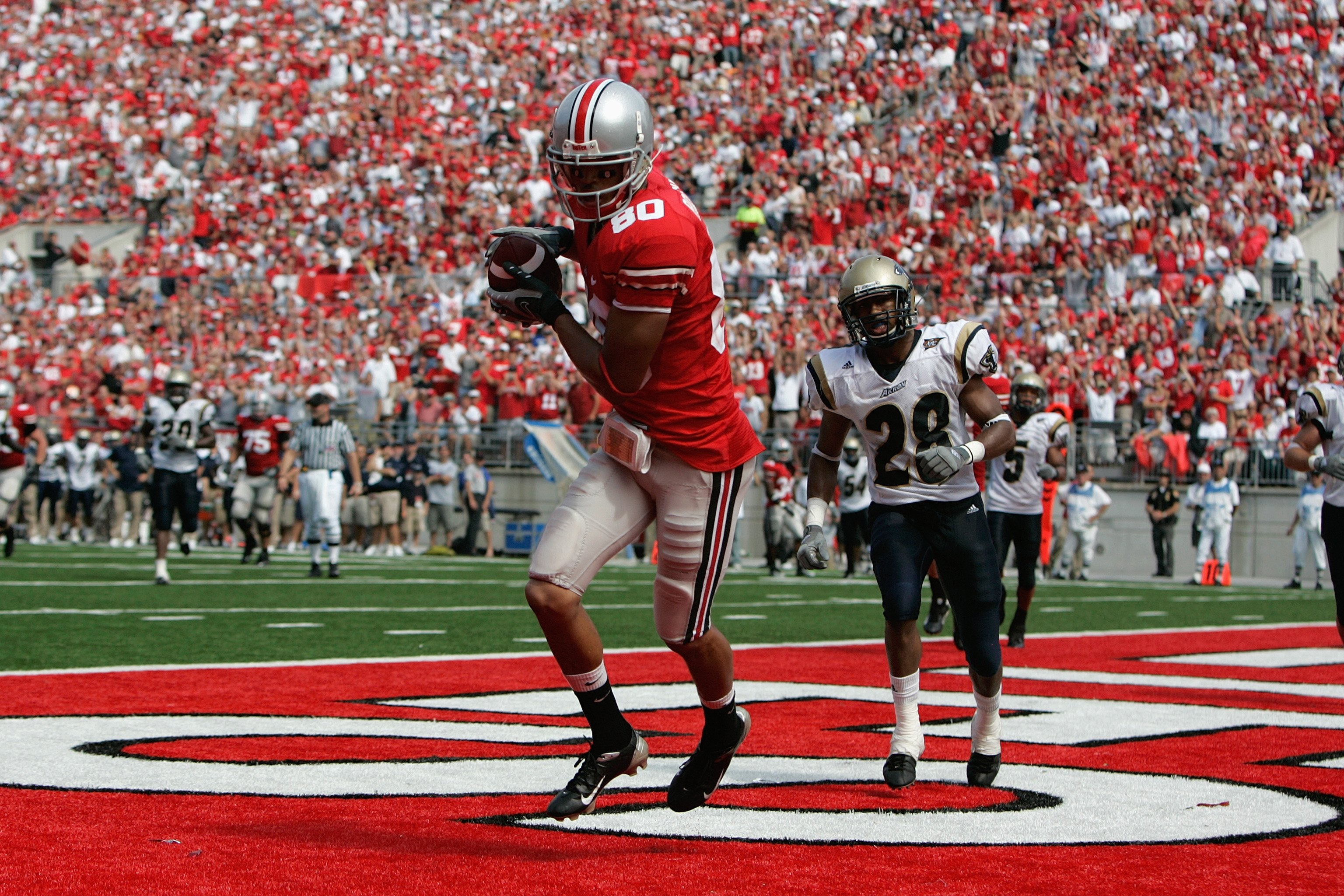 COLUMBUS, OH - SEPTEMBER 8:  Brian Robiskie #80 of the Ohio State Buckeyes scores a touchdown during the game against the Akron Zips at Ohio Stadium on September 8, 2007 in Columbus, Ohio. Ohio State won 20-2. (Photo by David Maxwell/Getty Images)