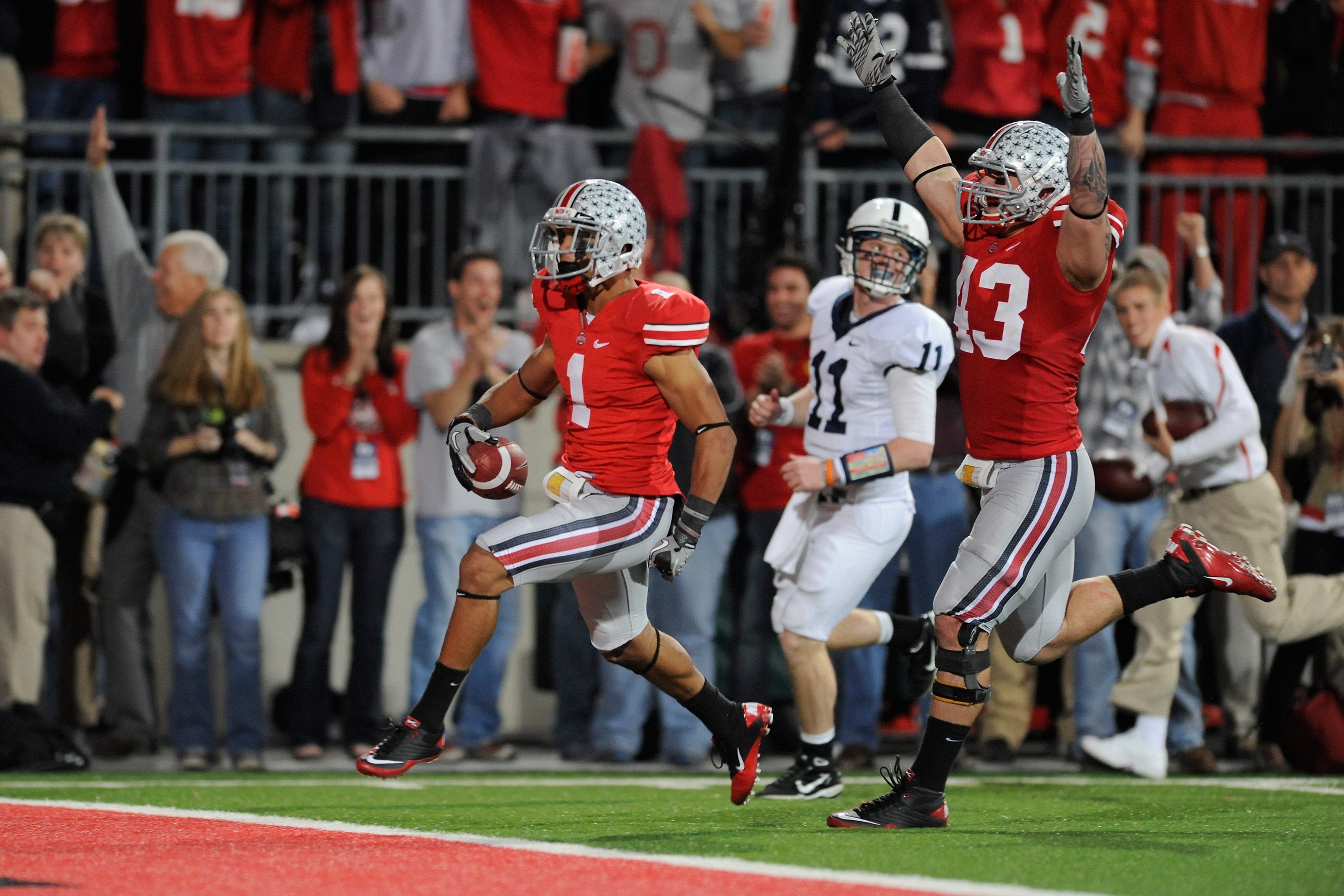 COLUMBUS, OH - NOVEMBER 13:  Devon Torrence #1 of the Ohio State Buckeyes scores on a 34-yard interception return in the third quarter as quarterback Matt McGloin #11 of the Penn State Nittany Lions pursues and Nathan Williams #43 of the Ohio State Buckey