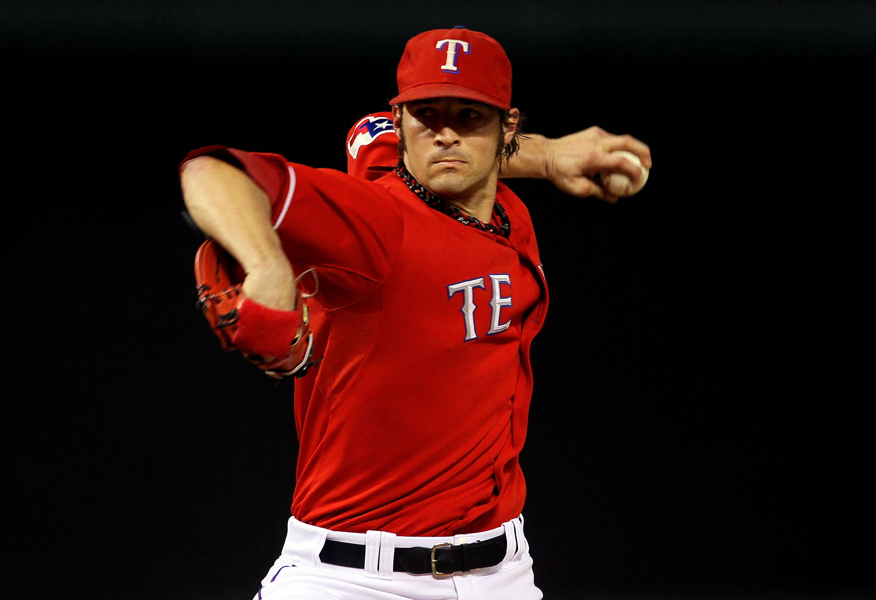 ARLINGTON, TX - OCTOBER 15: C.J. Wilson #36 of the Texas Rangers pitches against the New York Yankees in Game One of the ALCS during the 2010 MLB Playoffs at Rangers Ballpark in Arlington on October 15, 2010 in Arlington, Texas.  (Photo by Stephen Dunn/Ge