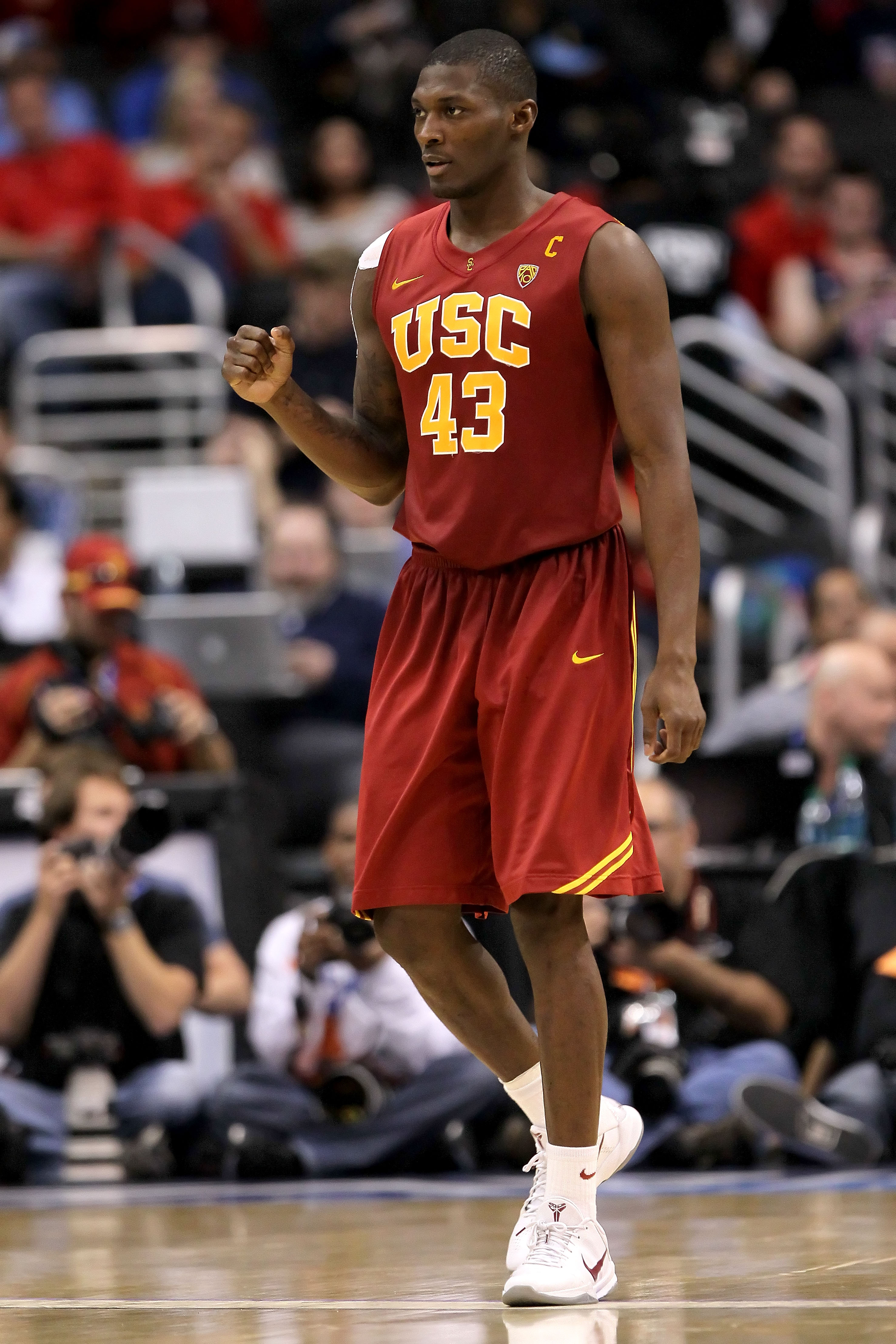 LOS ANGELES, CA - MARCH 11:  Marcus Simmons #43 of the USC Trojans reacts in the second half while taking on the Arizona Wildcats in the semifinals of the 2011 Pacific Life Pac-10 Men's Basketball Tournament at Staples Center on March 11, 2011 in Los Ange