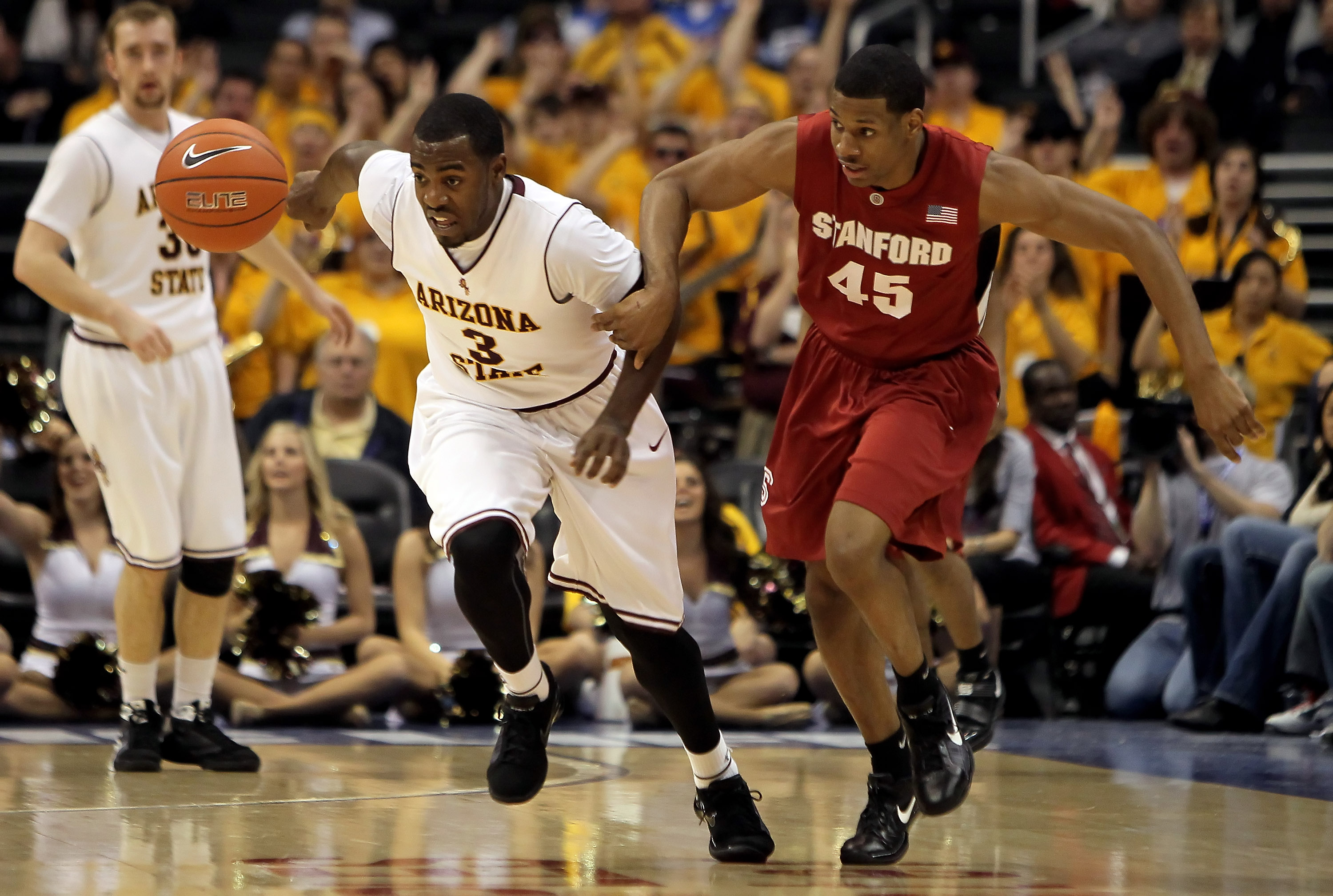 LOS ANGELES, CA - MARCH 11:  Ty Abbott #3 of the Arizona State Sun Devils and Jeremy Green #45 of the Stanford Cardinal fight for a loose ball in the first half during the Quarterfinals of the Pac-10 Basketball Tournament at Staples Center on March 11, 20