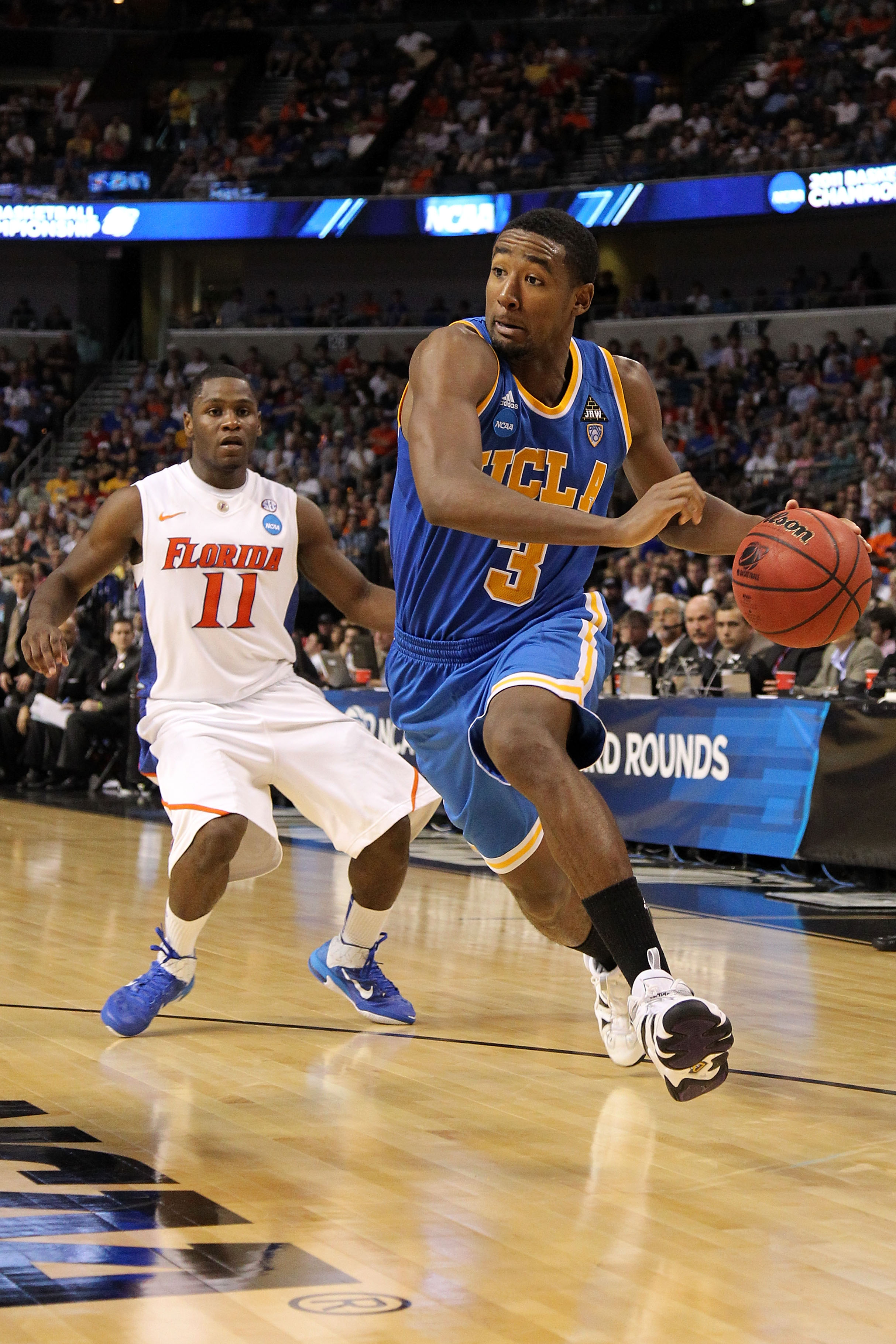 TAMPA, FL - MARCH 19:  Malcolm Lee #3 of the UCLA Bruins drives against Erving Walker #11 of the Florida Gators during the third round of the 2011 NCAA men's basketball tournament at St. Pete Times Forum on March 19, 2011 in Tampa, Florida.  (Photo by Mik