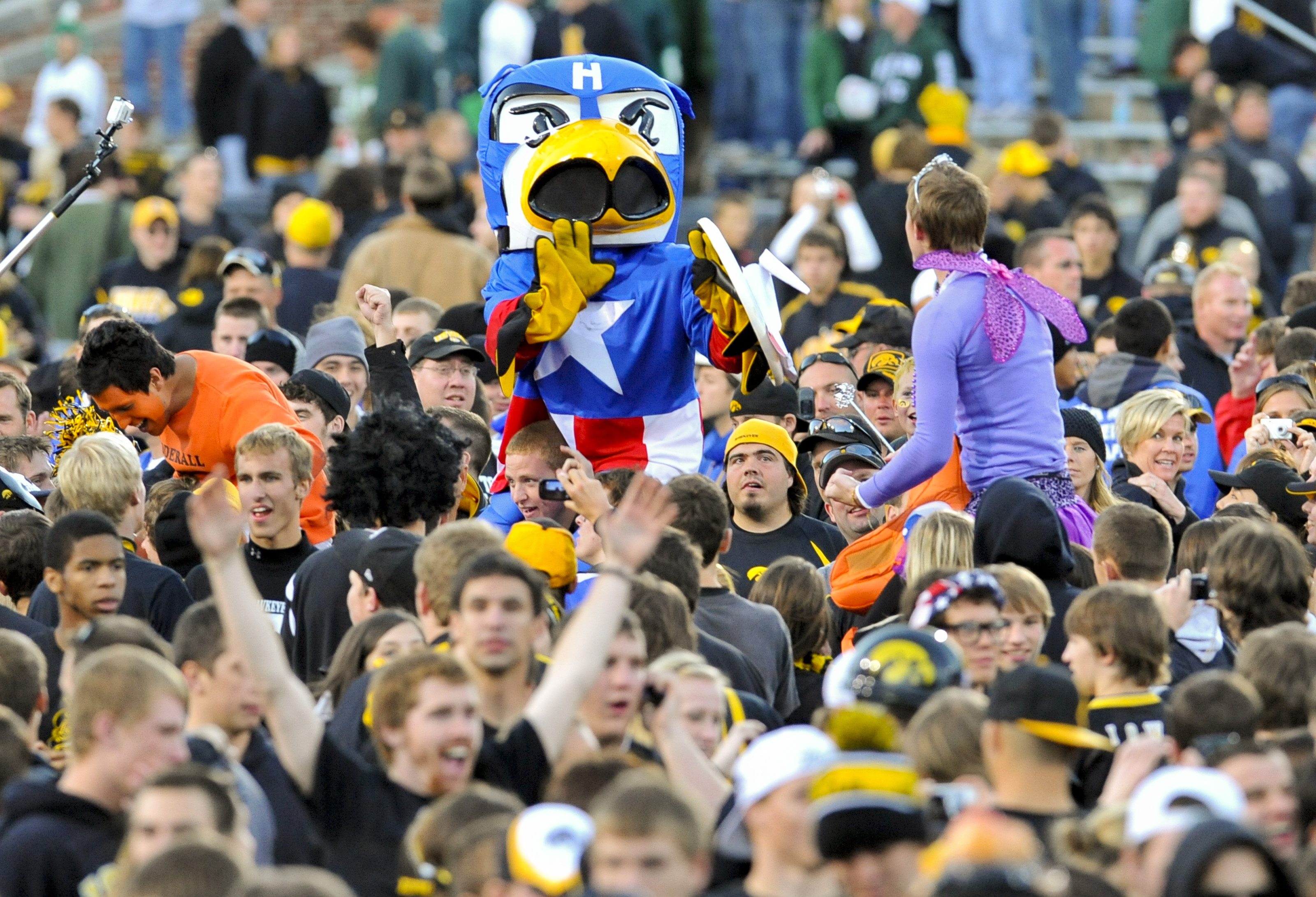 IOWA CITY, IA - OCTOBER 30: Dressed as Captain American Univeristy of Iowa mascot Herky the Hawk celebrates with fans after Iowa defeated the Michigan State Spartans at Kinnick Stadium on October 30, 2010 in Iowa City, Iowa. Iowa won 37-6 over Michigan St