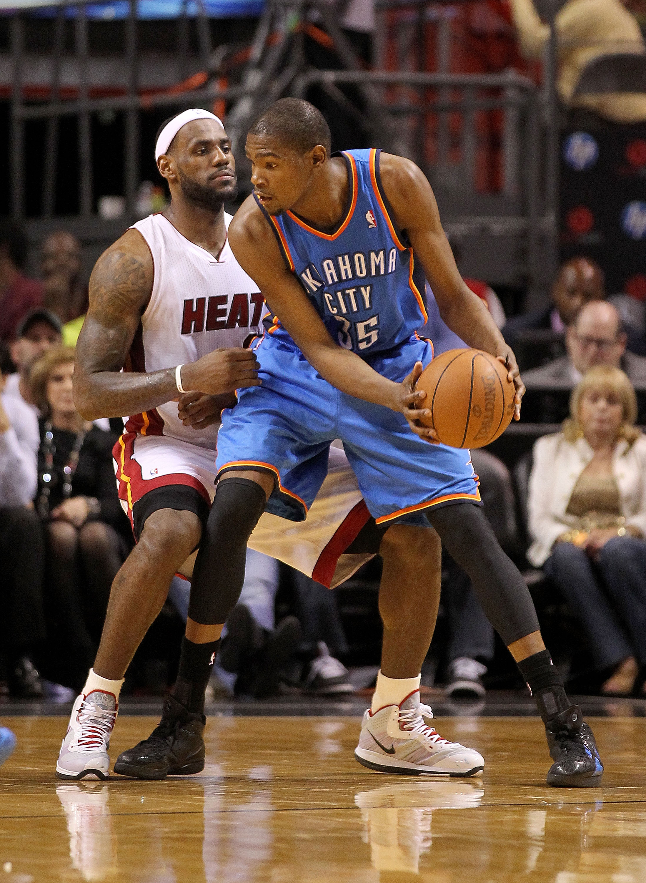 MIAMI, FL - MARCH 16:  LeBron James #6 of the Miami Heat guards Kevin Durant #35 of the Oklahoma City Thunder during a game at American Airlines Arena on March 16, 2011 in Miami, Florida. NOTE TO USER: User expressly acknowledges and agrees that, by downl